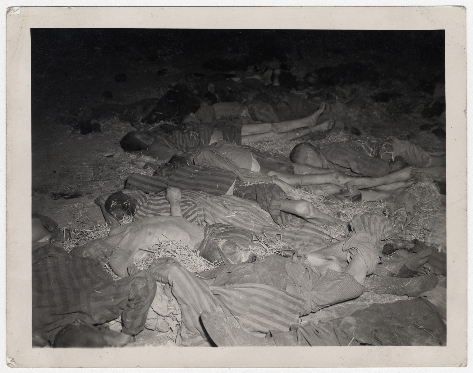 View of corpses on a straw laden floor in the Nordhausen concentration camp.