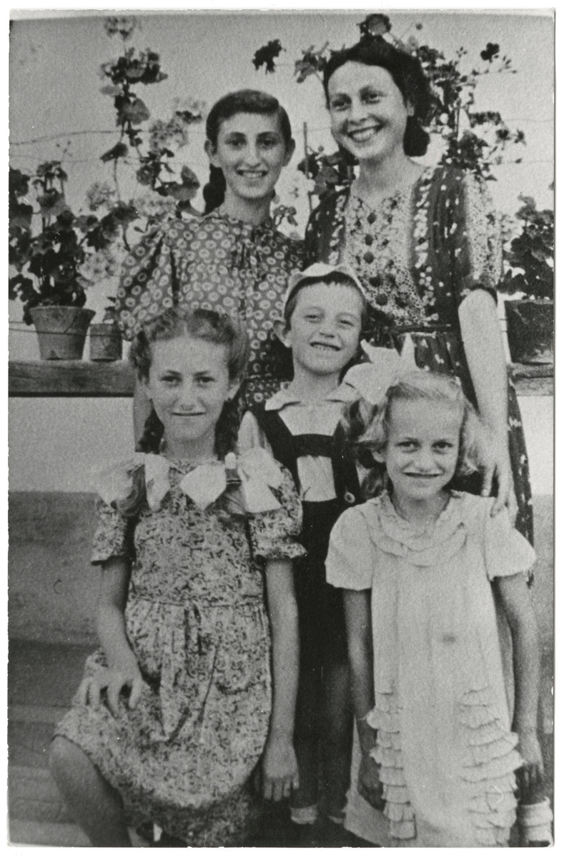 Group portrait of the Fogel and Klarman families.    Pictured in the front row are Iren Fogel, Zoltan Klarman, and Edith Fogel.  Back row: Serena Fogel and Bella Klarman.