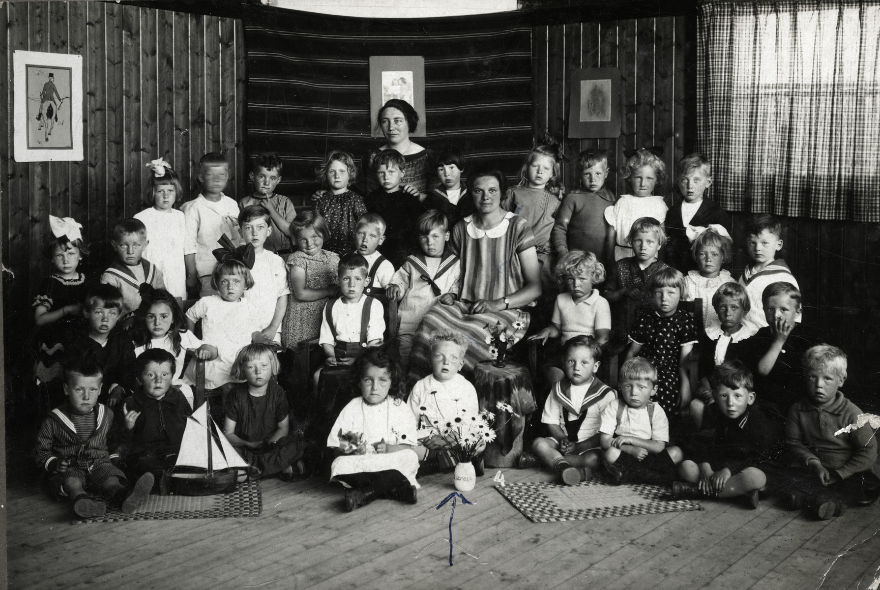 Group portrait of children in a kindergarten in Amsterdam.  Among those pictured is Jacques Kok.
