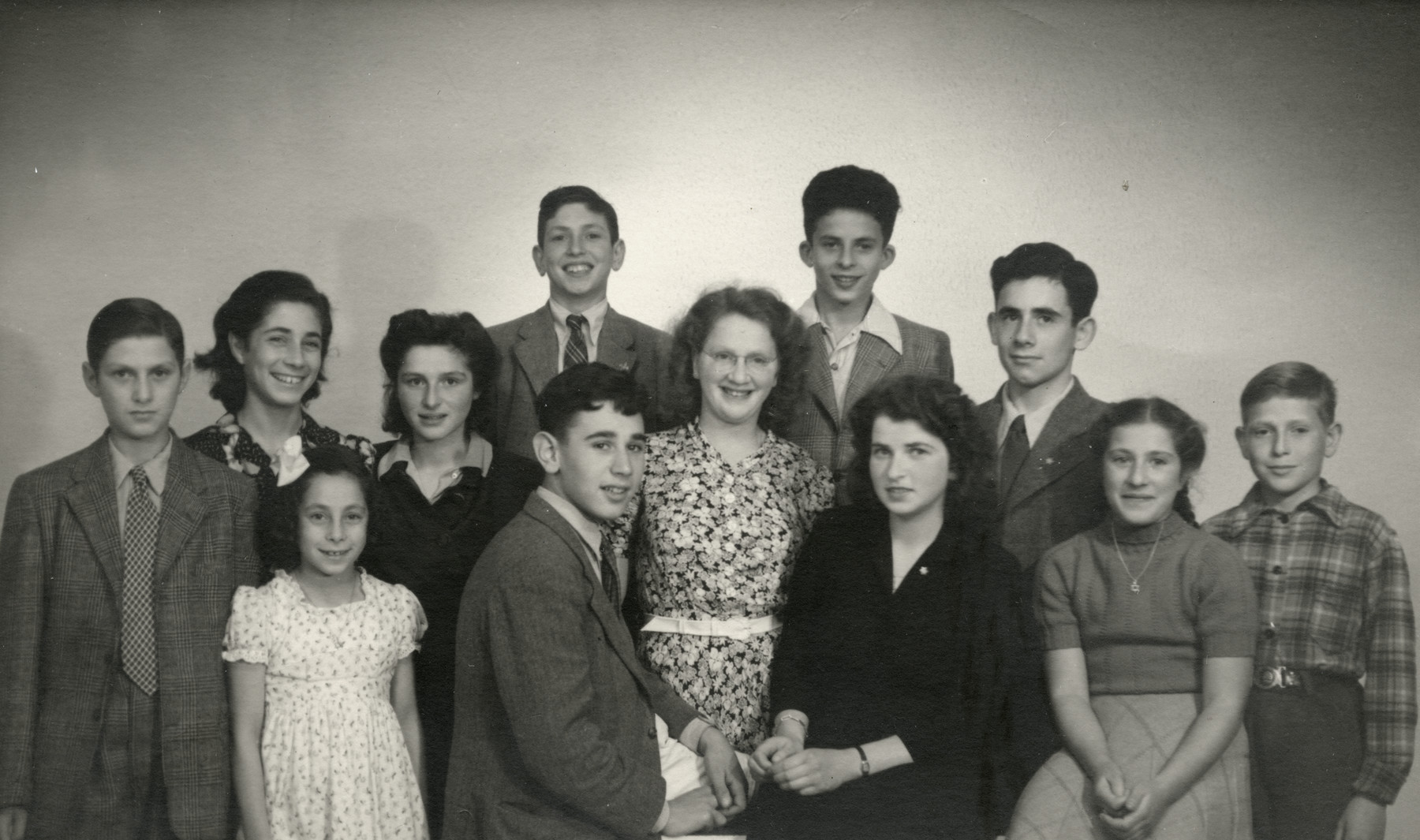 Group portrait of children in a postwar children's home in the Netherlands where Betty Kok worked as a counselor.  Pictured front row (left to right) are Joop Wertheim (Yehuda Vardi), Miriam Levy (later Yarons), Theo Stibbe, Betty Kok (van Essen), Gien Wertheim and Dick Boek.  Second row: Renate Levy, Blume Ulsch, Henk Piel, Margalit Gompers, Chaim Gomes de Mesquite and Arnold van Galder.
