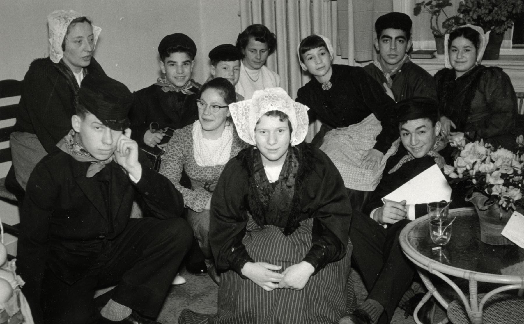 Group portrait of children wearing their Purim costumes in the Bergstichtung postwar children's home run by Ezrat Hayeled.