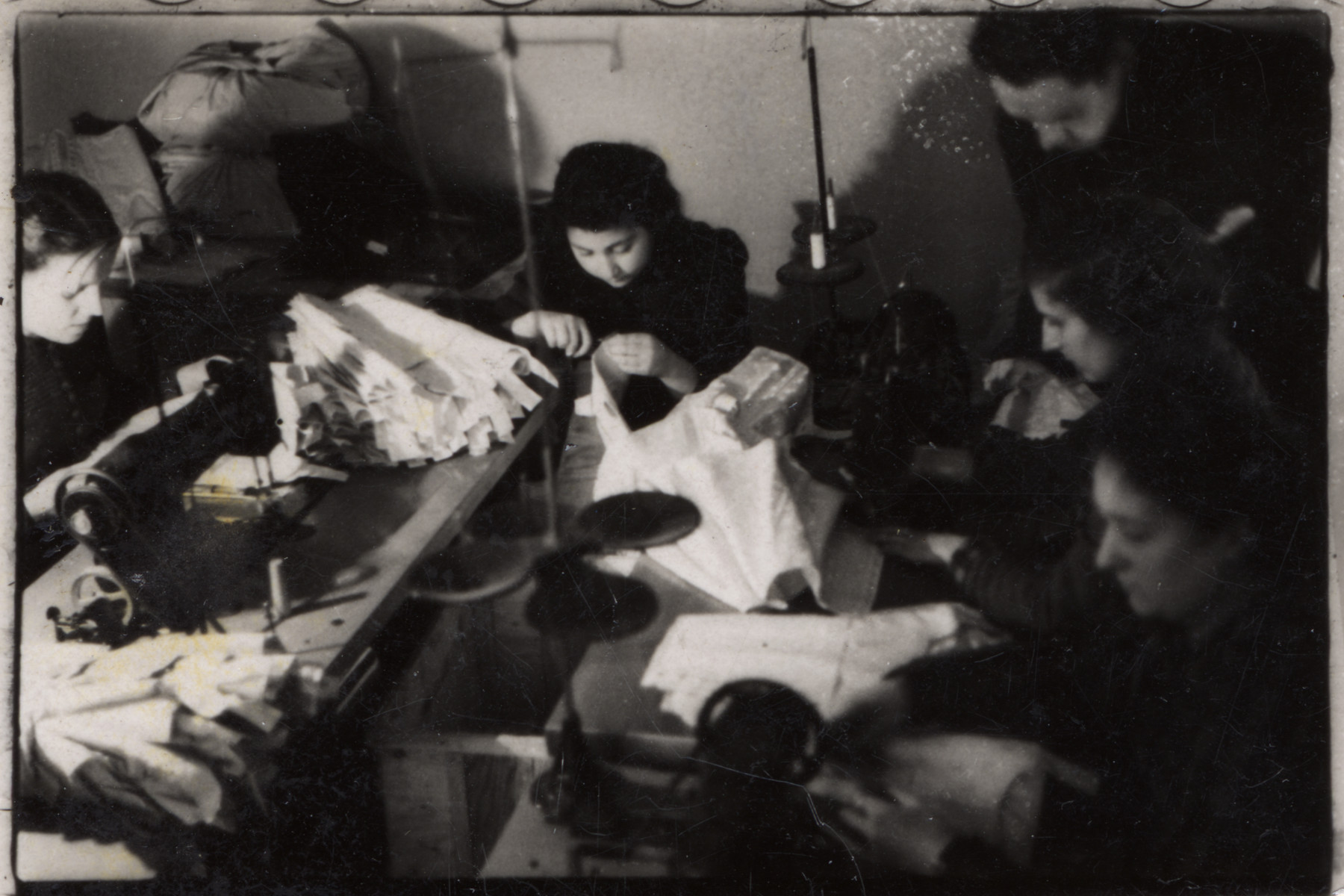Women at work in one of the spinning workshops of the Lodz ghetto.