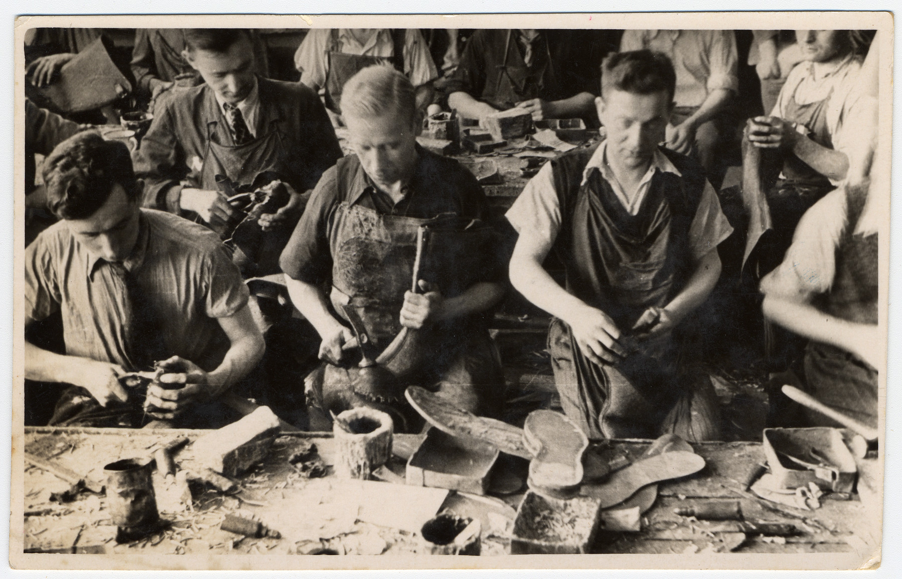 Men at work in one of the shoe factories of the Lodz ghetto.