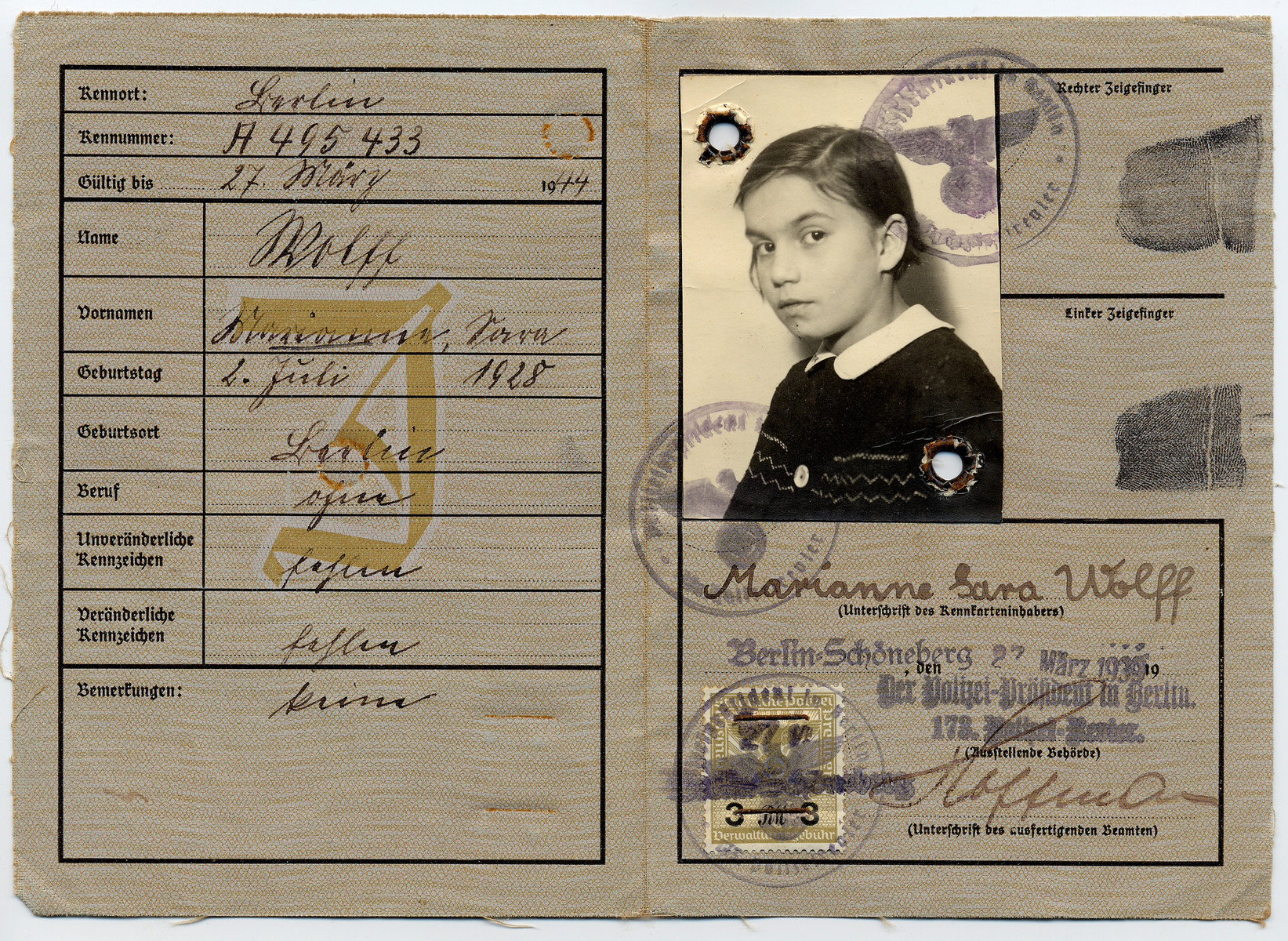"Identity card (Deutsches Reich Kennkarte) issued to Marianne Wolff displaying the imposed middle name of ""Sara"" and stamped with the letter J for ""Jude"" (Jew)."