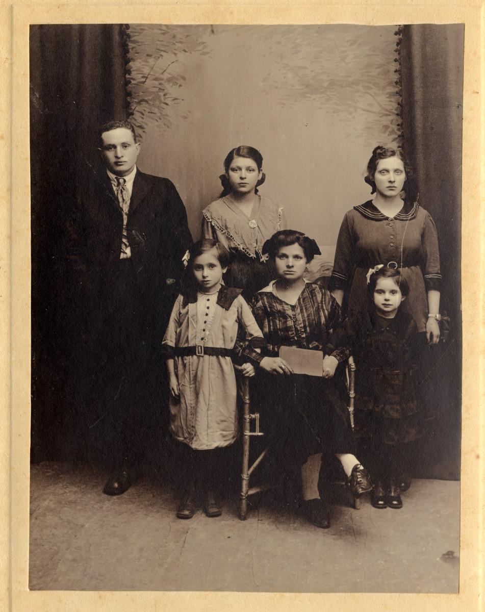 Studio portrait of the Rosenbaum family.  Pictured from left to right; in the back row are Bernard Baruch Rosenbaum, Bernice Bryna Rosenbaum (later Goldberg), and Rosa Rosenbaum (later Lopata). Front row: Frieda Altaman, Ida (Chaya) Altman) and Leah Rosenbaum.