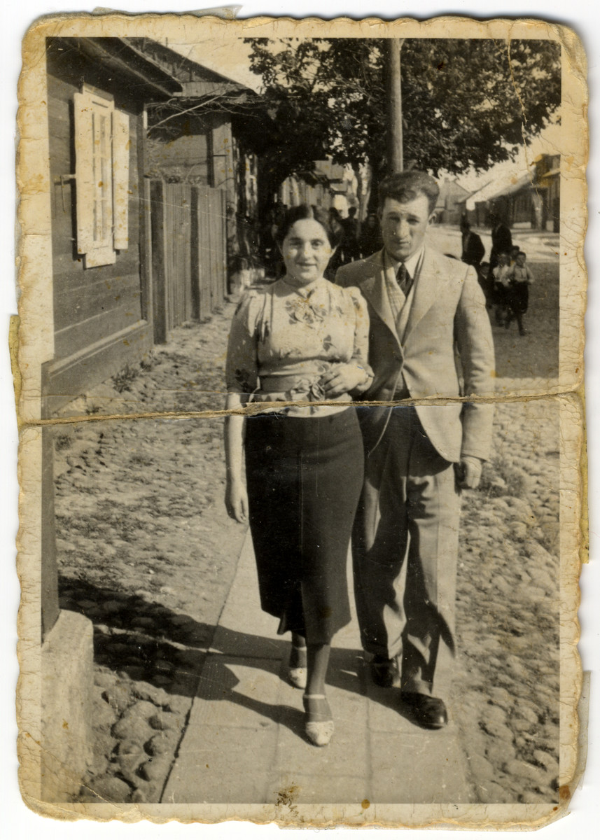 Mendel Feldman down the street with his girlfriend, Frieda Altman (later Feldman).