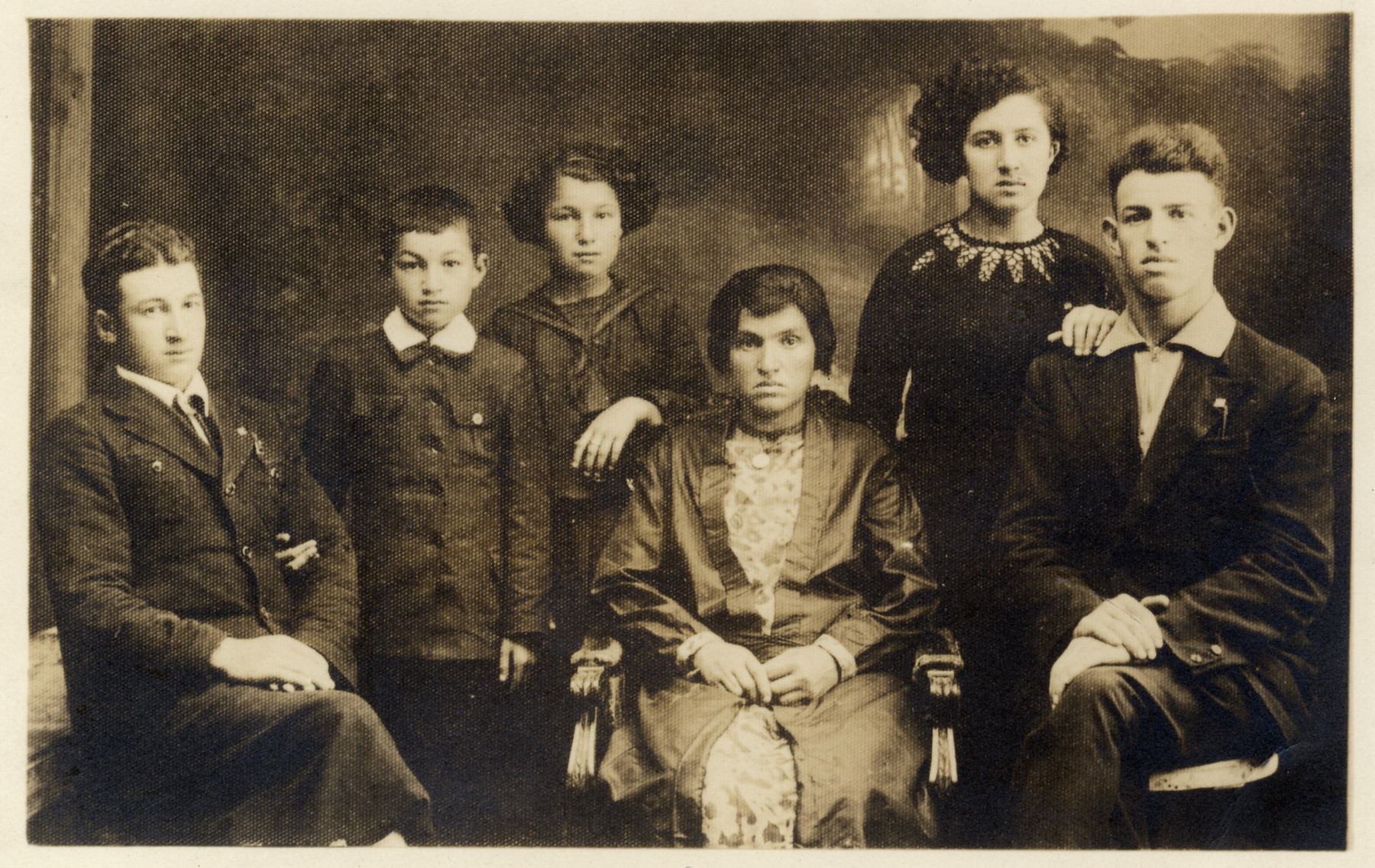 Prewar studio portrait of the Feldman family in Sokolow Podlaski.  Seated from left: Mendel, Moishe Velvel, Surah Rifka, Chinka Schwartzburt Feldman (their mother), Shoshana and Fischel Feldman.