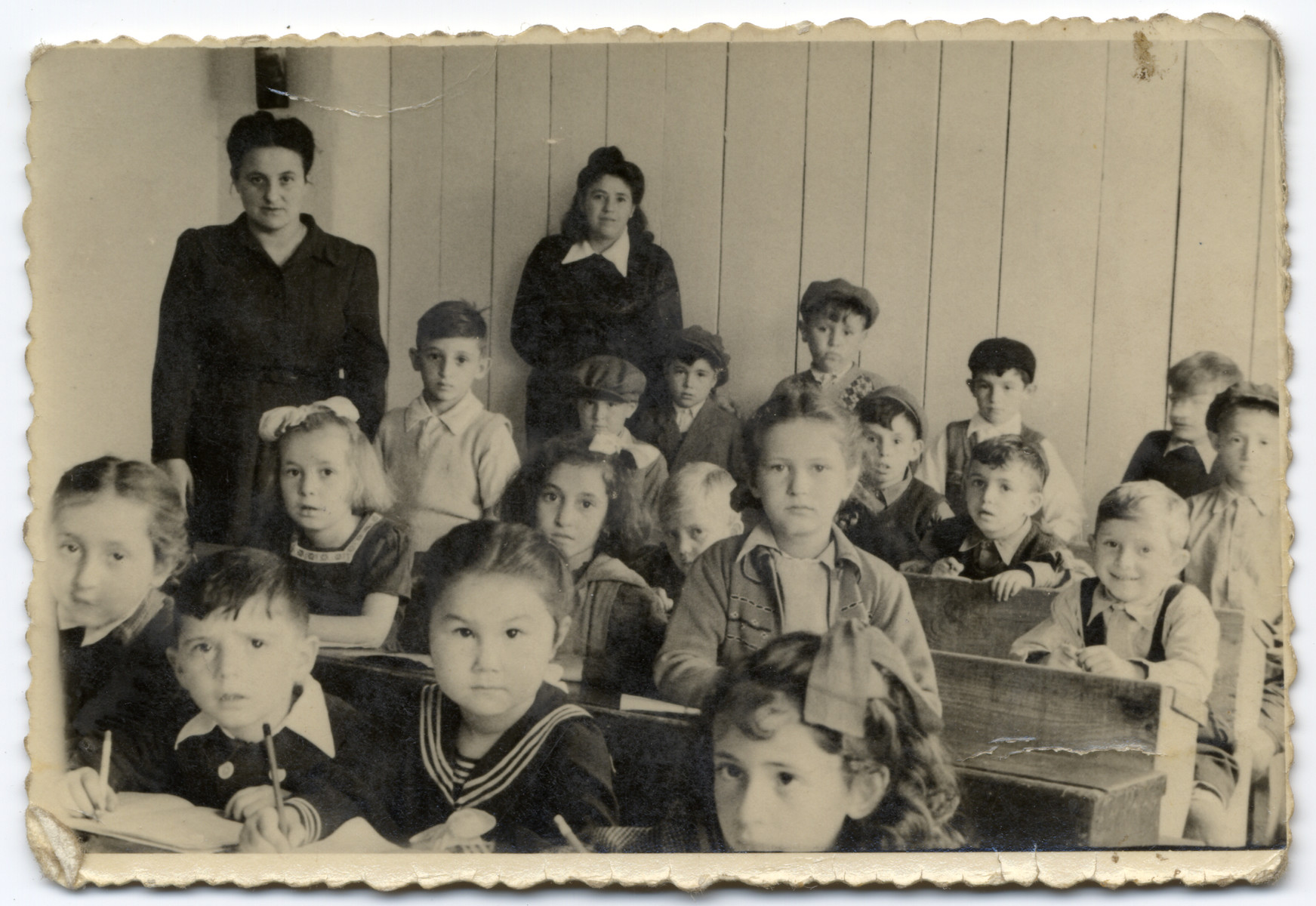 Young children study in a classroom in an elementary school in the Wels displaced persons' camp.  Fred (Efraim Yitzhak) Feldman is pictured (3rd row far right).