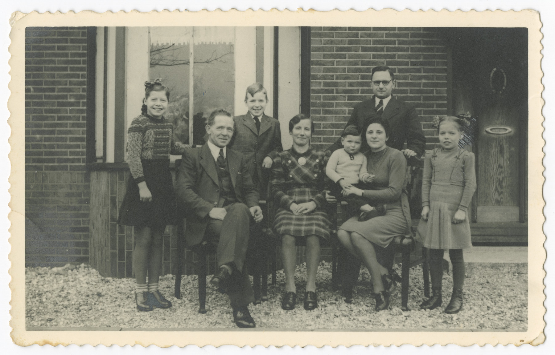 Rabbi Yitzhak Jewdwab, his wife Lena and son Aaron pose with the family of their rescuers, the Wevers after liberation.  Lena Jedwab knit the sweater of the older daughter on the left.