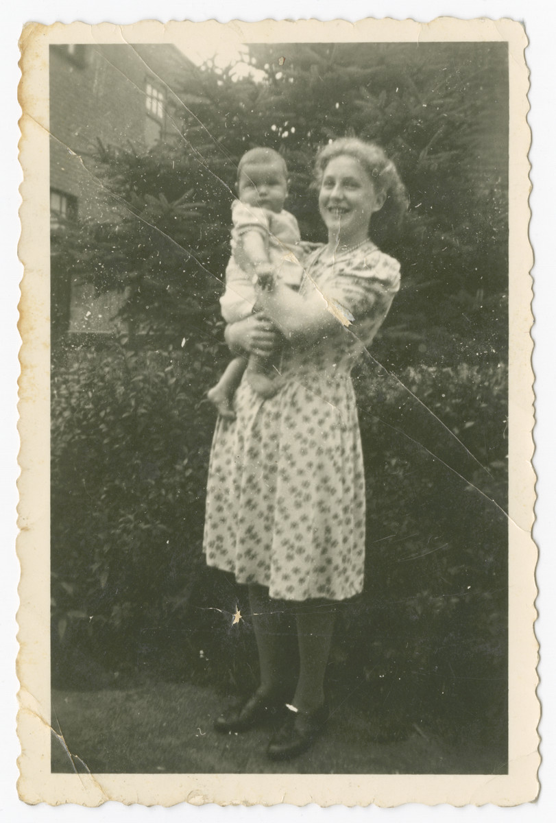 Henny Wikkerink holds her foster brother, Aaron Jedwab, a Jewish infant in hiding as Jan Willem Herfstein.