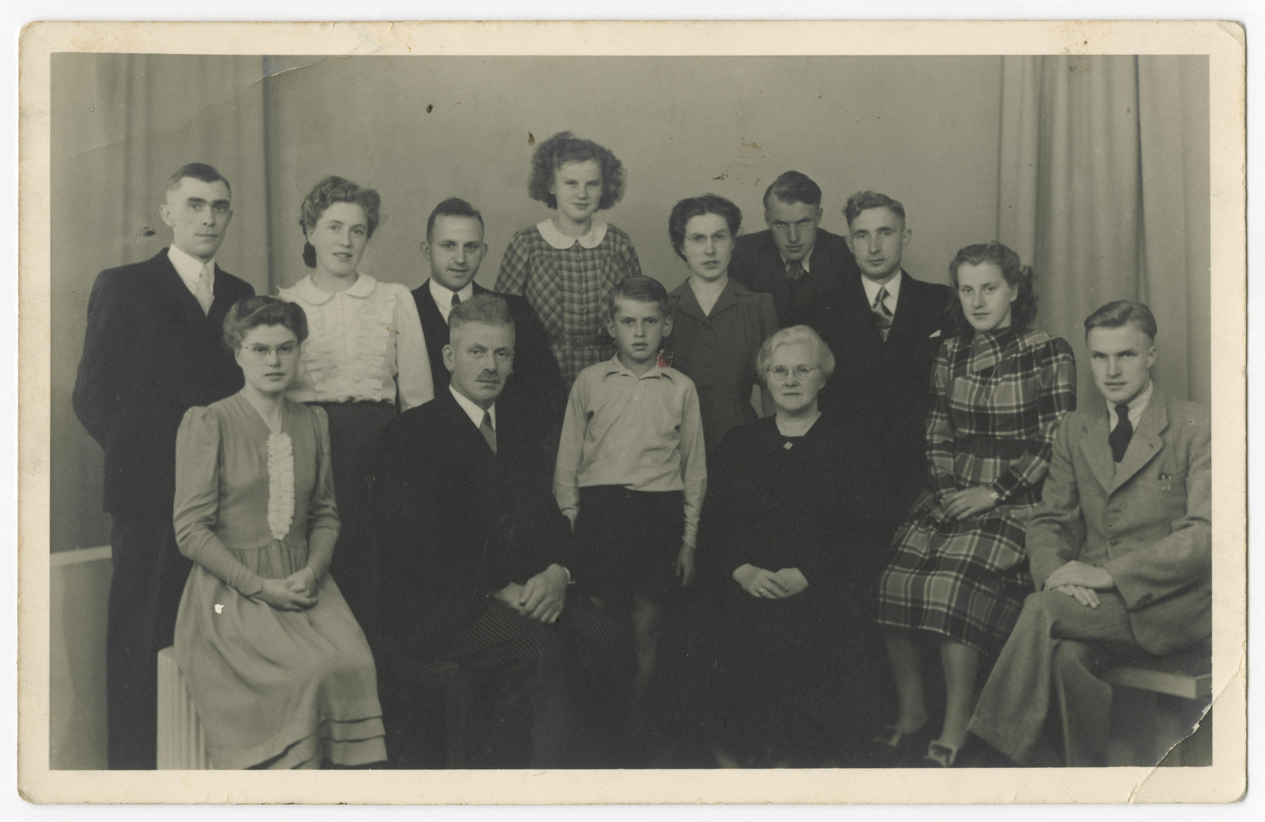Studio portrait of Jan and Dela Wikkerink, Righteous Among the Nations, and their eight children.  Jan, also known as Ome Jan (Uncle Jan) was a founder and leader of the resistance in Aalten.