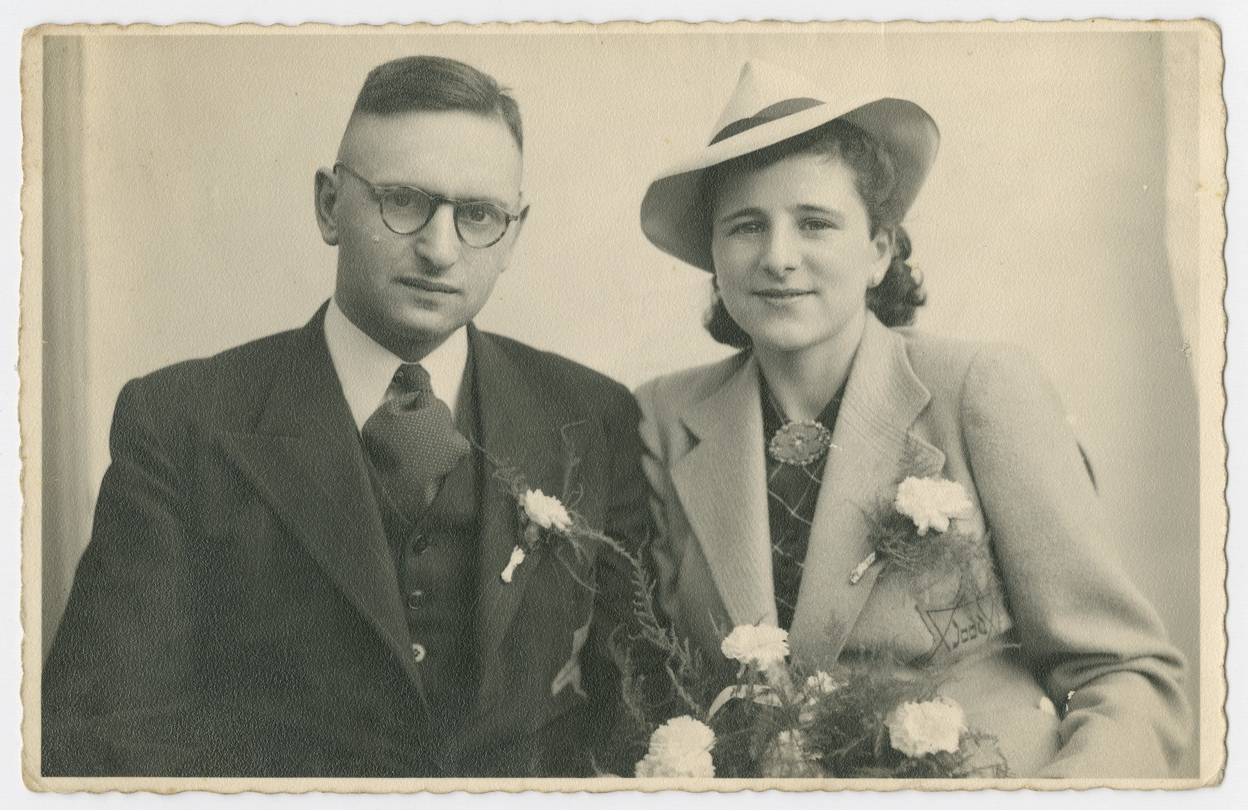 Wedding portrait of Lenny Kropveld and Rabbi Yitzchak Jedwab.  Both are wearing Stars of David.