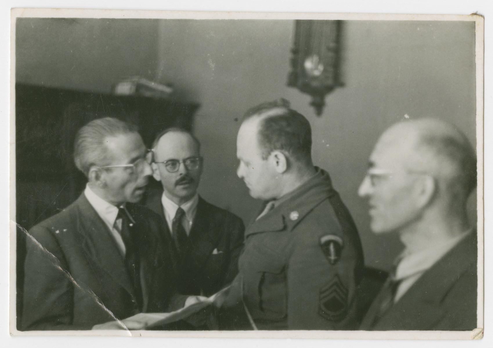 Jewish American serviceman and JDC aid worker David Eizenberg meets with three men in postwar Berlin.