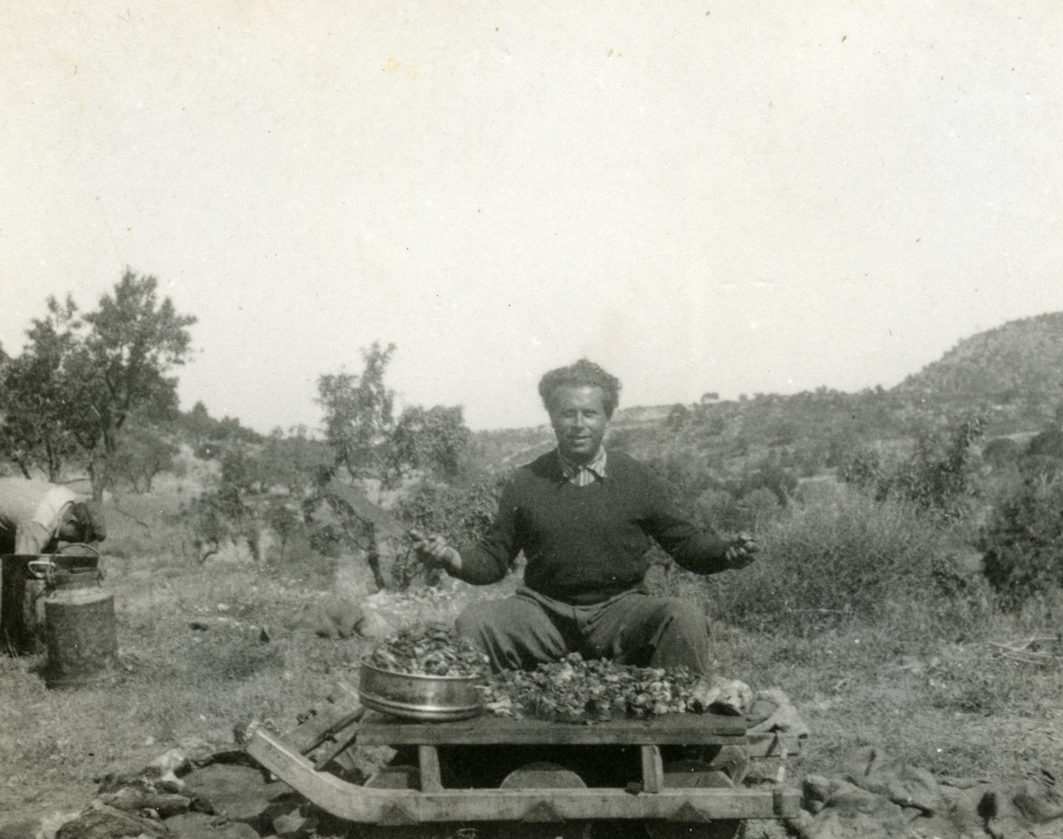 Victor Tulman cooks in a makeshift outdoor kitchen during the Spanish Civil War.