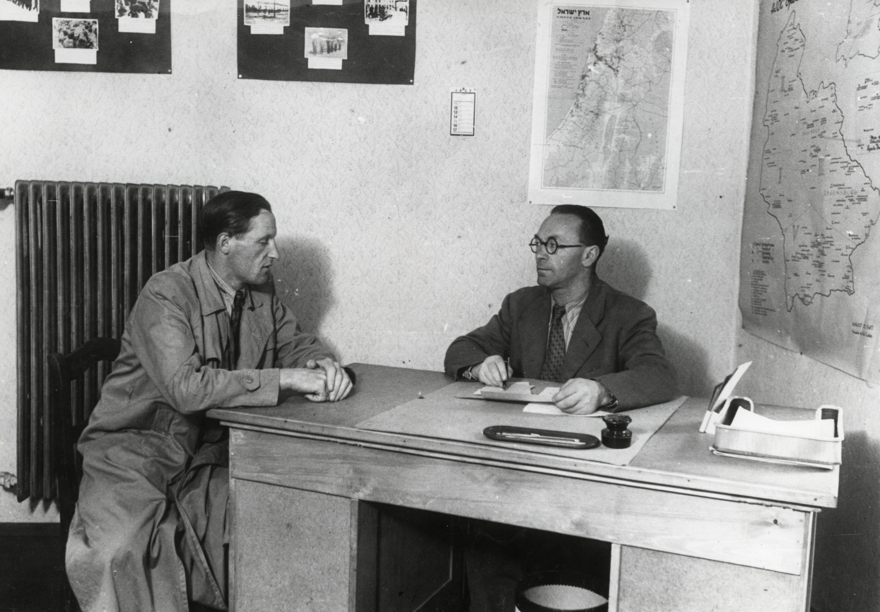 Writers David Wolpe (left) and Israel Kaplan work in their office in the Munich displaced persons' camp.