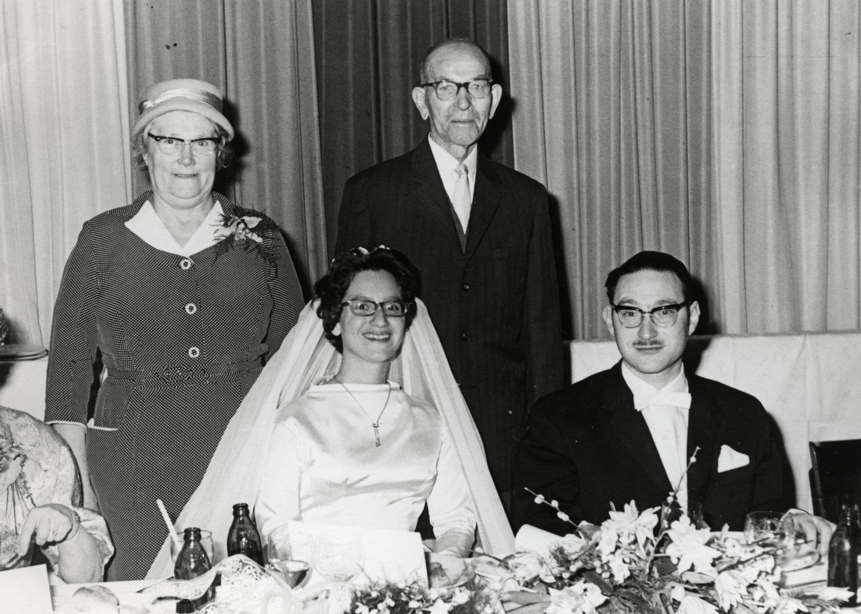 Ruth Eisenmann (Lange) poses with her rescuers at her wedding.  Pictured are Ruth and Gershon Lange and Bertha Hugygens-Busch and Meryn Hugygens.