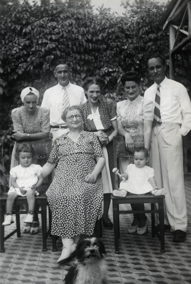 Group portrait of Jewish refugees in Haiti.  On left: Erich Meinberg with his wife Ruth Milziener (wearing a turban) with cousin Anita  and child. Eva's mother (Herta Mayer) is in the middle. On right: Tilly Milziener who married local a Haitian Geo de Landes (next to her)