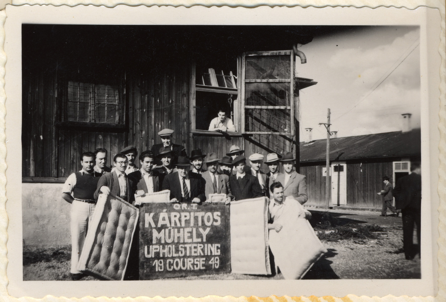 A group of Jewish men pose with the mattresses they made in the ORT upholstering course in the Hallein displaced persons' camp.
