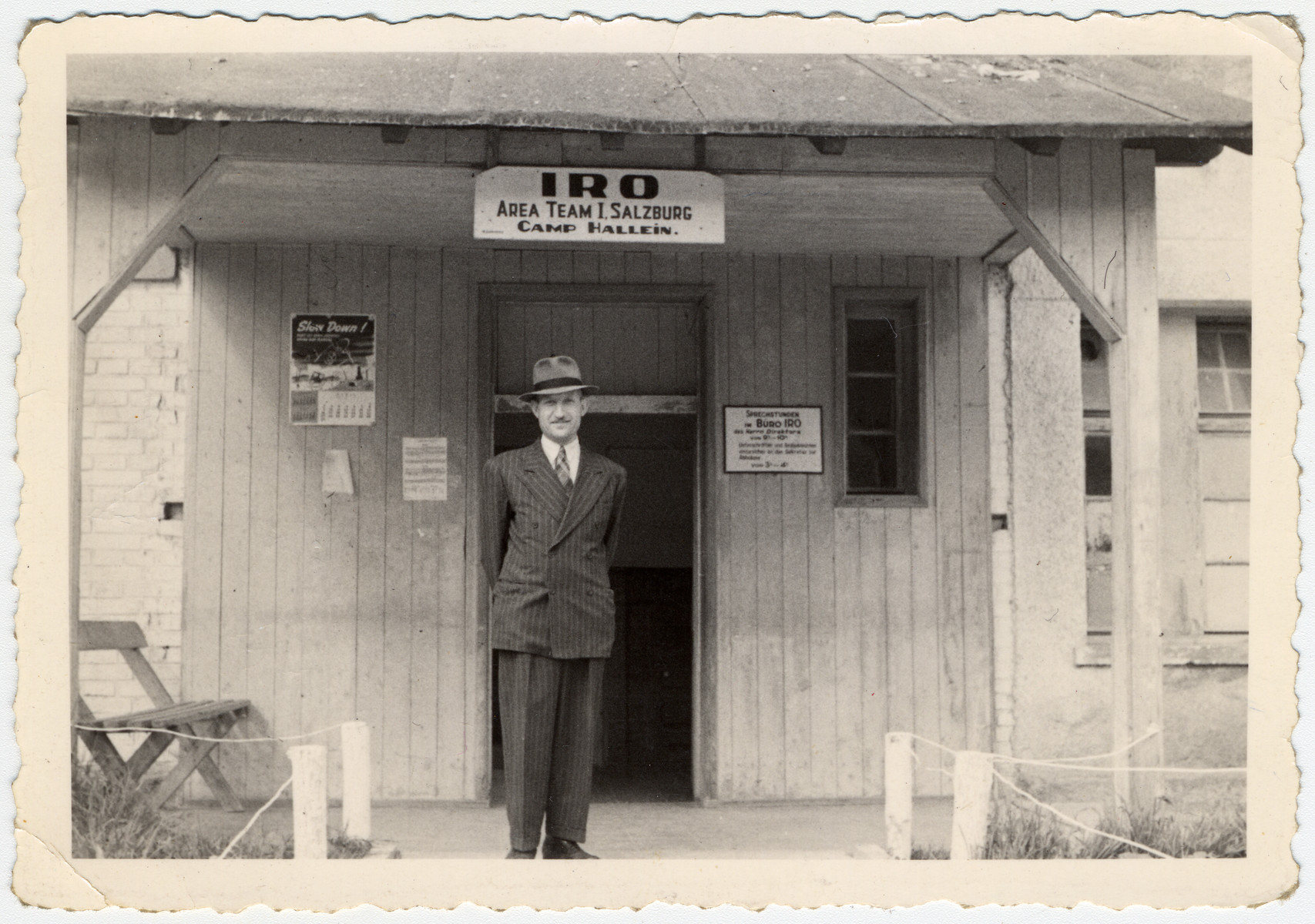 Eliezer Freedman stands outside the administrative building of the Hallein displaced persons' camp.