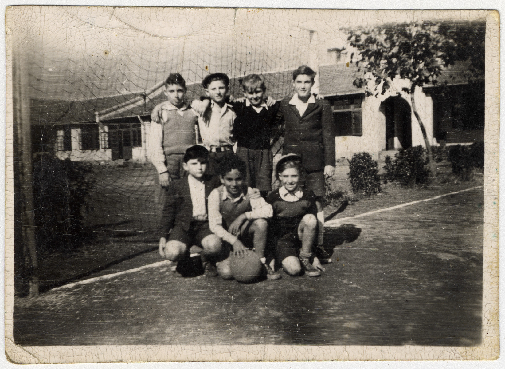 Group portrait of a child's soccer team in postwar Shanghai.  Pictured left to right are Sello Fish, Hudi Munczel, manfred Loebel (the donor), Neger, Qwiet, Borris and Posner.