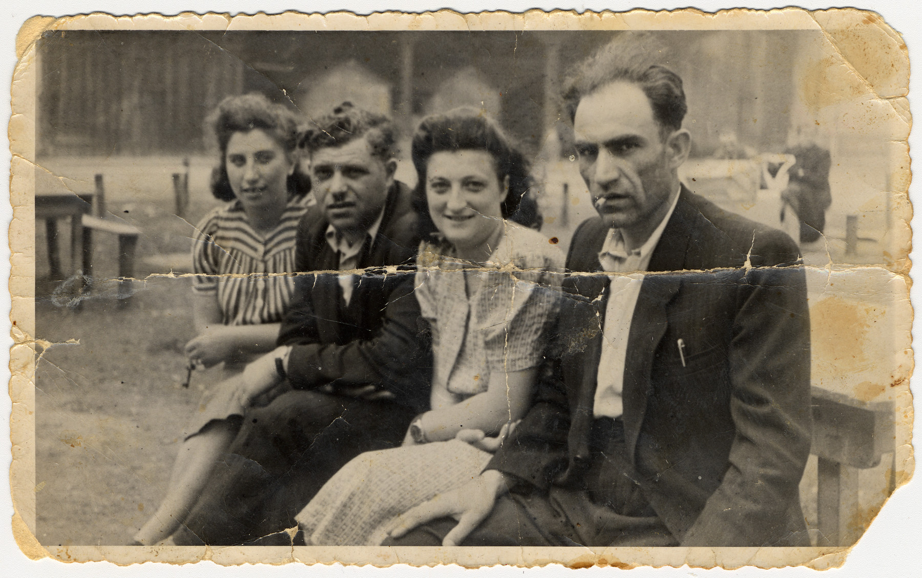 Portrait of two Jewish couples in the Deggendorf displaced persons' camp.  Pictured in the center are Moses and Mania Leinwand, and on the ends are Peila and Avrumchik Leitner.
