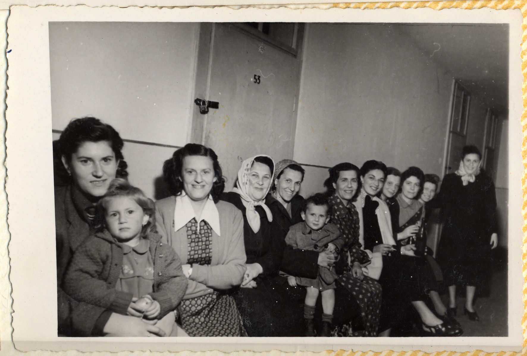Group portrait of Jewish women, some holding young children on their laps, in the Hallein displaced persons' camp.