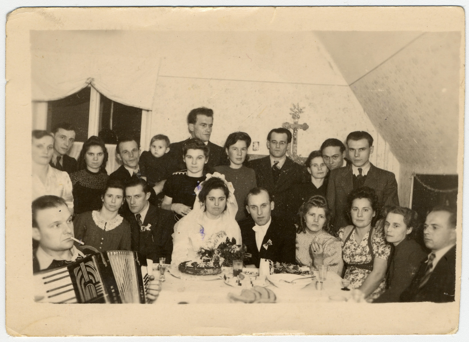Wedding celebration of Maria Pedrycz and Jan Kowalski     Irena Wójcik (Irene Wojtas) is seated next to the groom; her future husband Eugeniusz (Eugene) Wojtas, is standing in the back row, directly behind the bride.