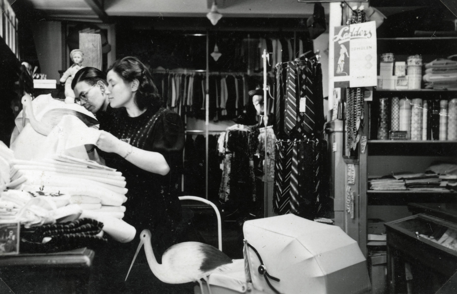 Betty Rosenbaum's parents shop for their baby's layette in the store of the Zion family in Eibergen.