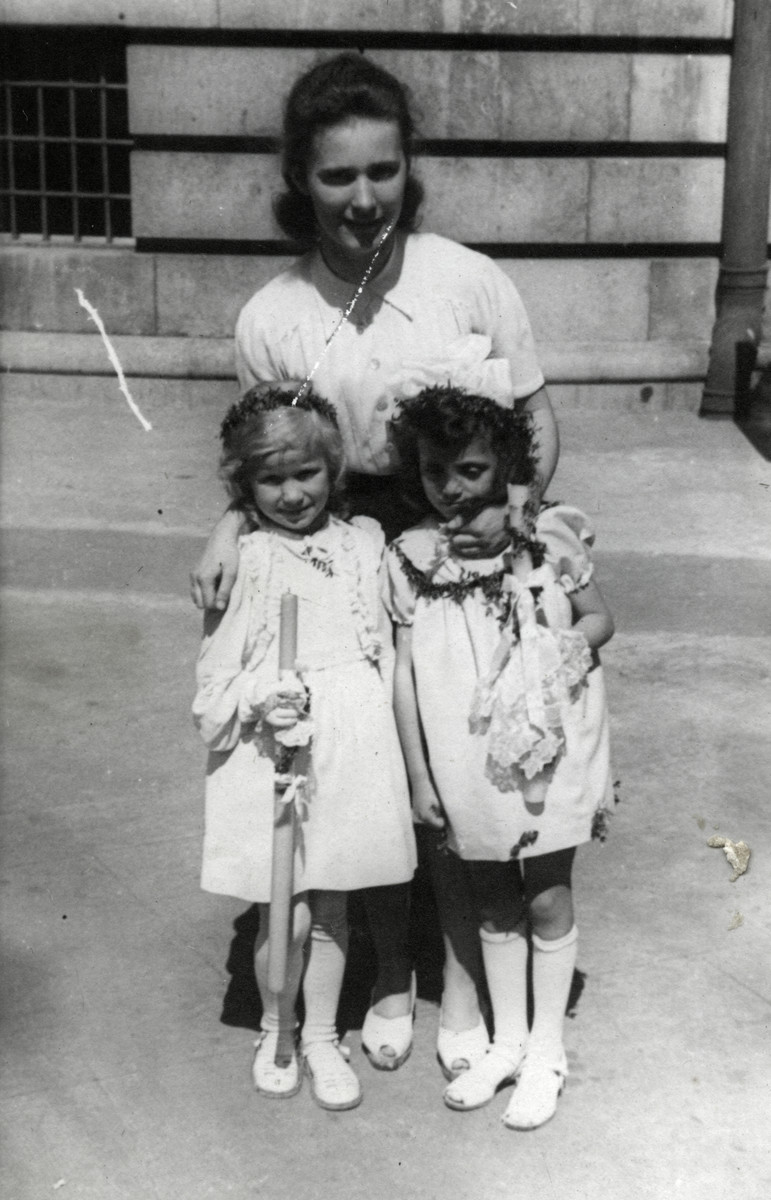 Regina Navrodska poses withJanina Nebel, a Jewish child her family hid, and another little girl.