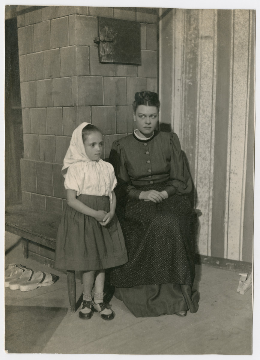 Janina Nebel, a Jewish child in hiding, acts in a German play that traveled to different villages.