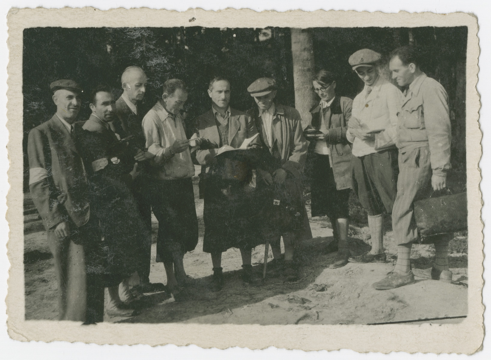 Jewish men in the  Karpaten Oel labor camp near Boryslaw pray outside.  The man standing fourth from the right has been tentatively identified as  Moses (Mojsesz) Fried (b. April 27, 1900 in Boryslav, Poland).