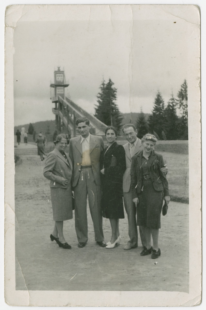 Group portrait of young adults standing in a park.  Among those pictured are Szymon Bur and his fiancee Genia Josefsberg.