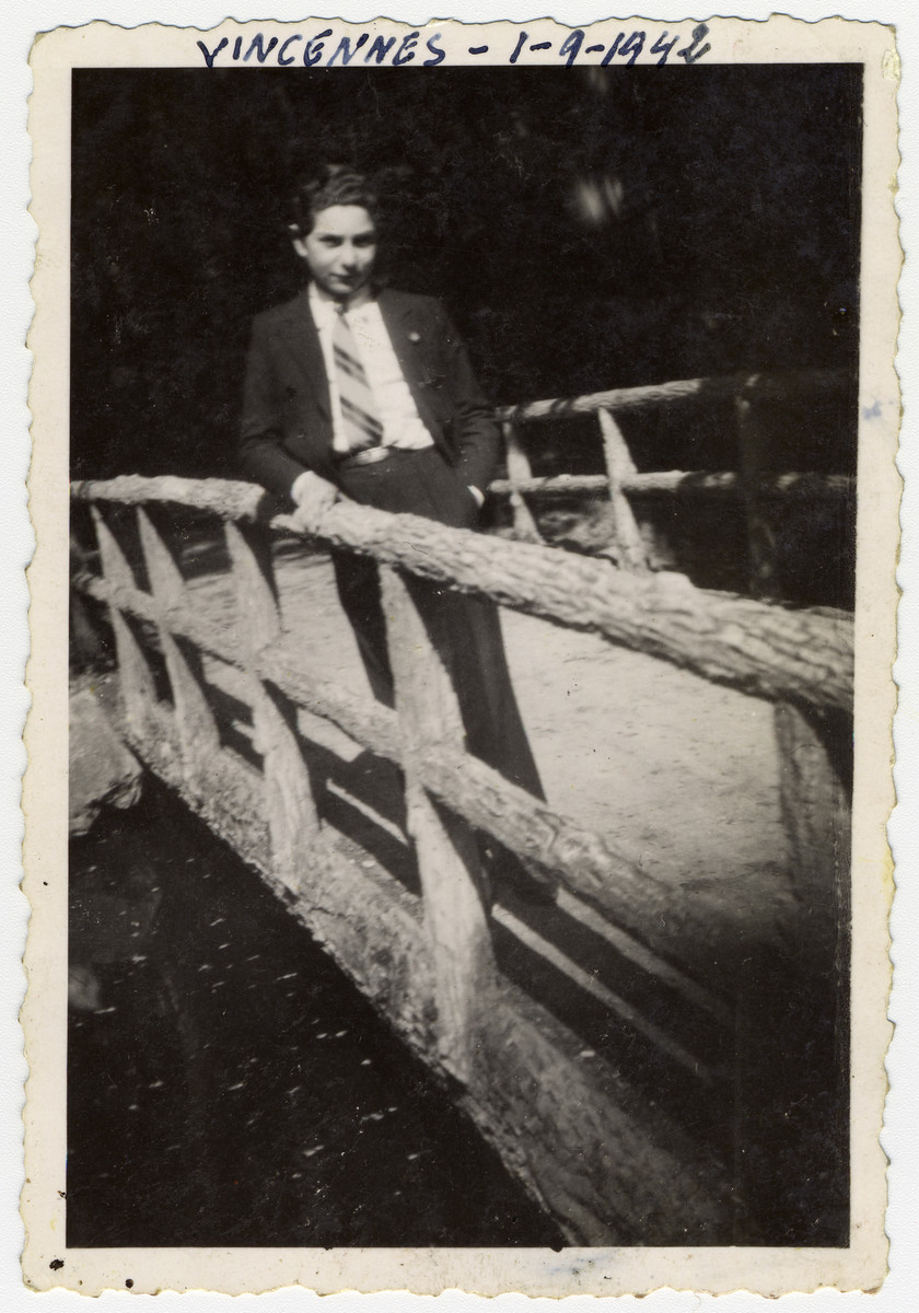 Close-up portrait of Samual Schulman, a Jewish teenager born in America, standing on a bridge in Vincennes.