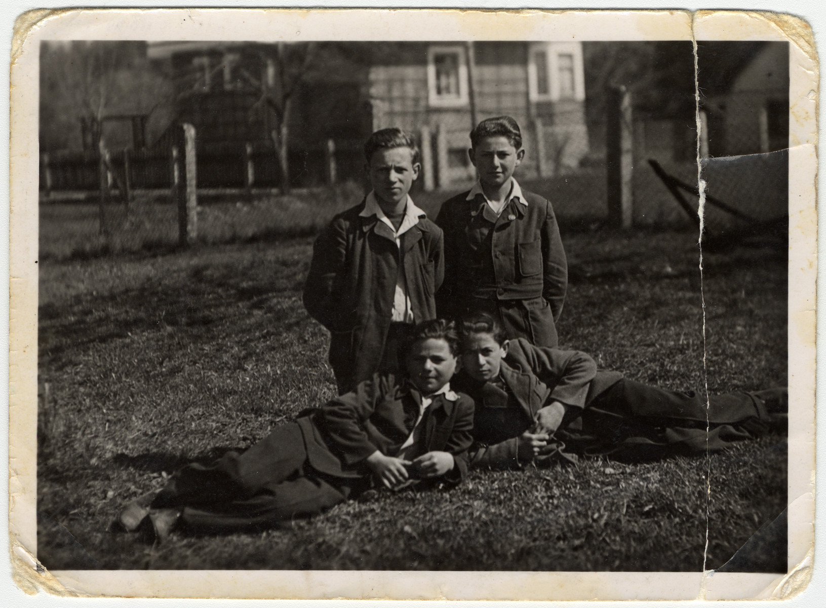 A group of young teenagers poses on the grounds of the Rosenheim displaced persons' camp.  Among those pictured is Tzvi Brill (second row, right) and Hirsch Yakubowicz who was killed by the British while a passenger on board the Exodus.
