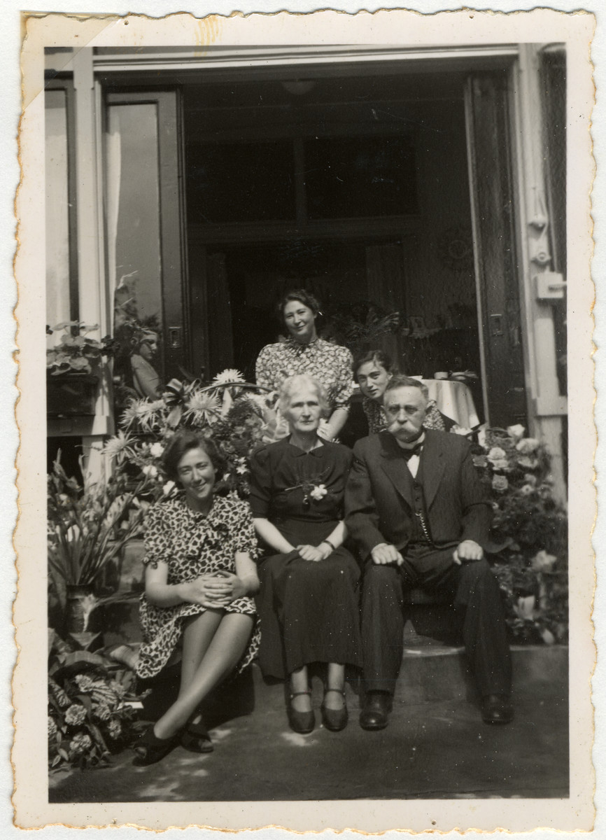 The van Dam family poses outside their home in Enschede.  Pictured sitting Hetty, Clara and Isidoor van Dam.  Standing are Minnie and Edith.