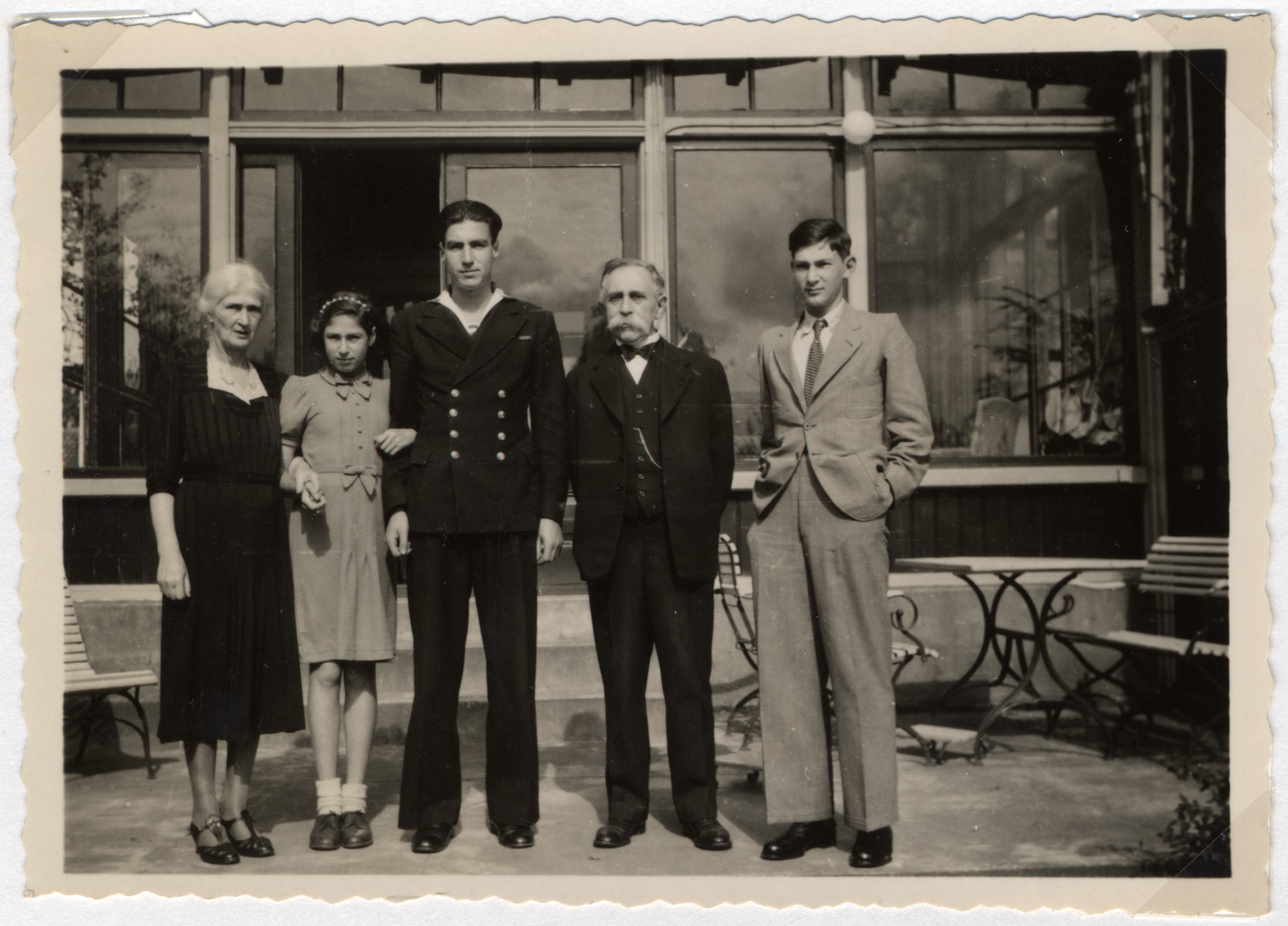 Members of the van Dam family poses for a group portrait after the war.  From left to right are Clara van Dam, Clary Vromen, Eric Besthoff (the son of Edith van Dam who served in the Dutch Marine Corps during the latter half of the war), Isidoor van Dam and Jaap Vromen.