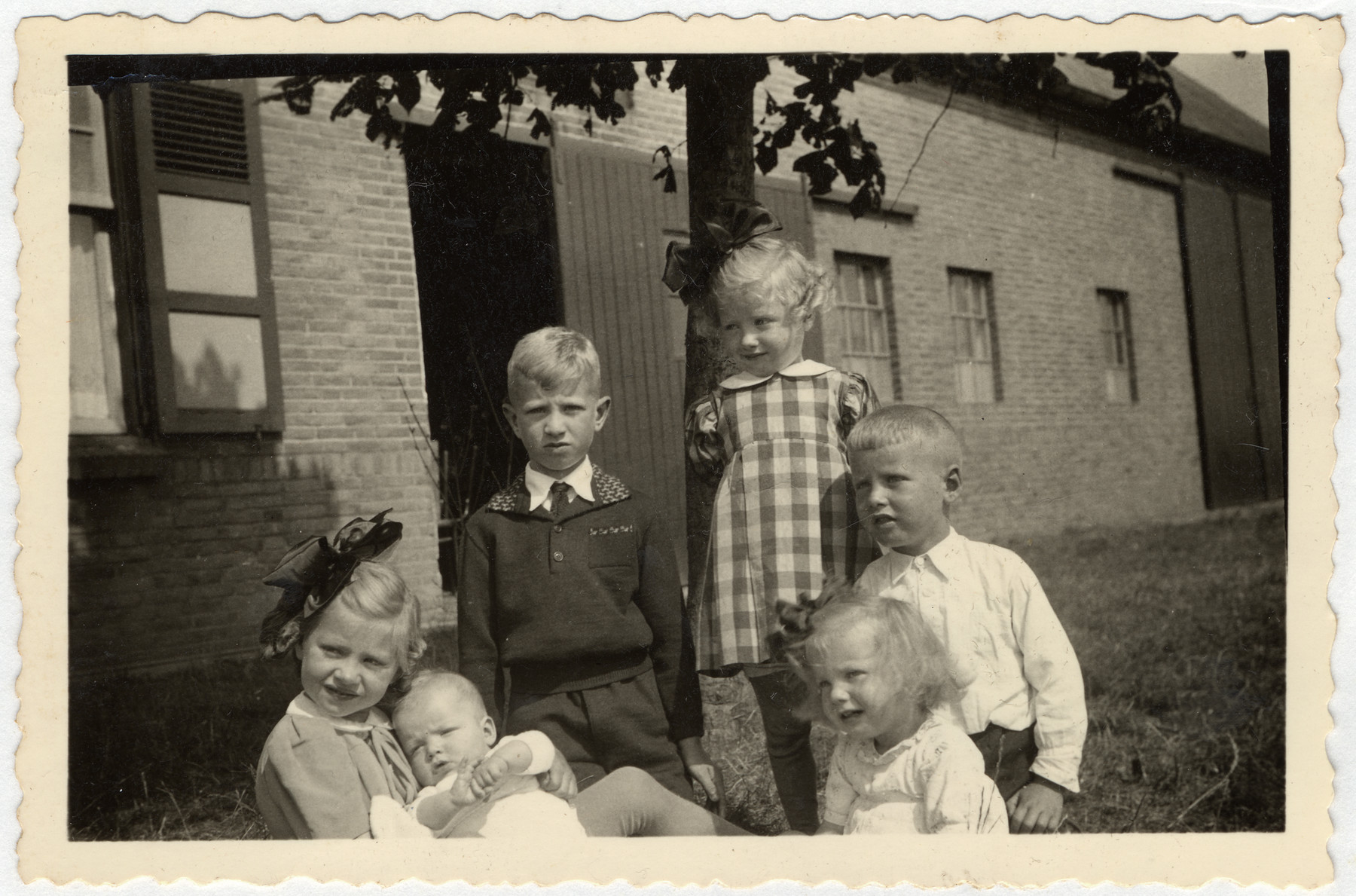Portrait of six young children of a farmer in southern Holland where Minnie van Dam was hiding.  She did housework for the family and cared for the children.  Pictured are Nellie, Christiaan, Maria, Antoon, Joke and Jan van Hiet.