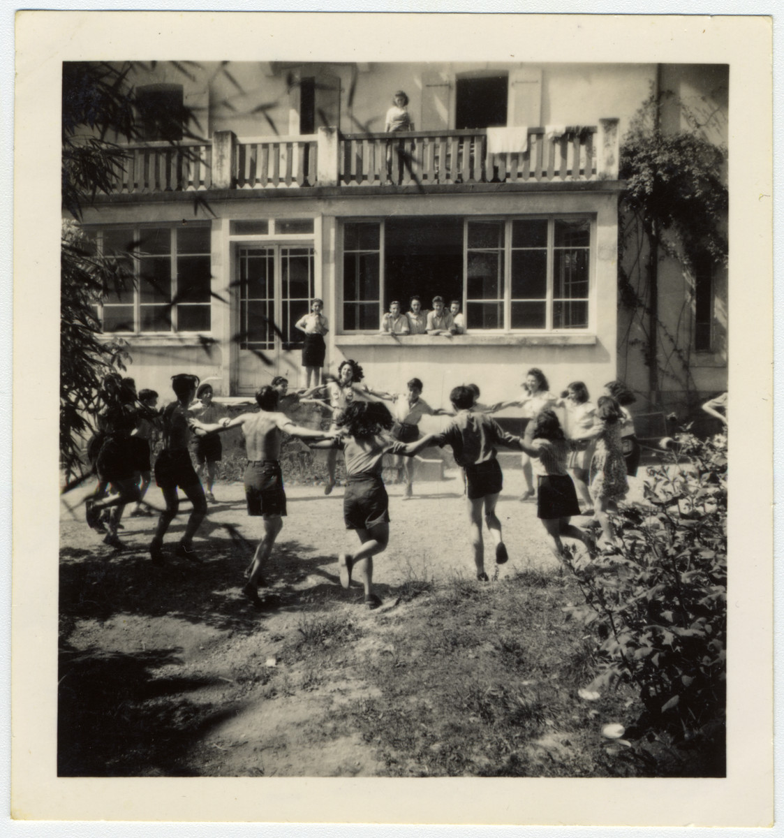 Jewish teenagers dance a hora outside the children's home in Versoix, Switzerland.