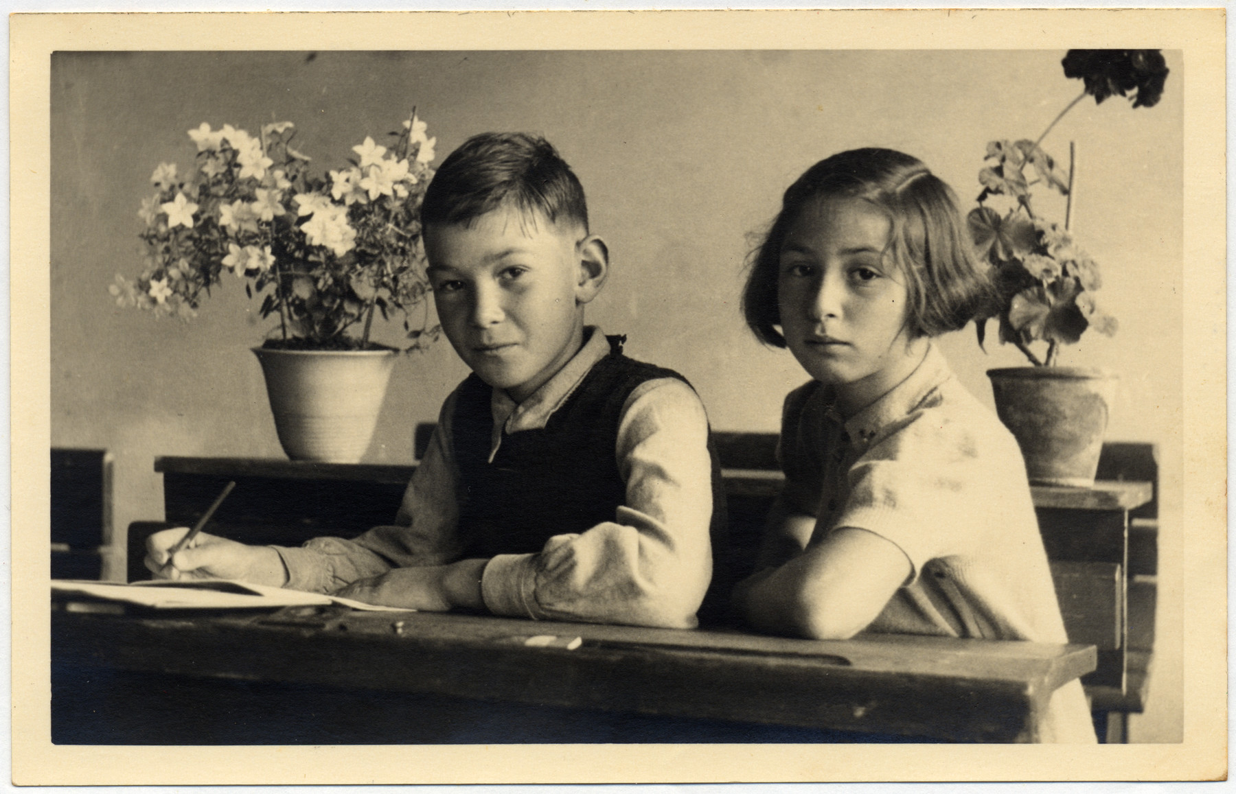 Jaap and Clara Vromen, a Dutch Jewish brother and sister work, at a desk a few months after the German invasion.