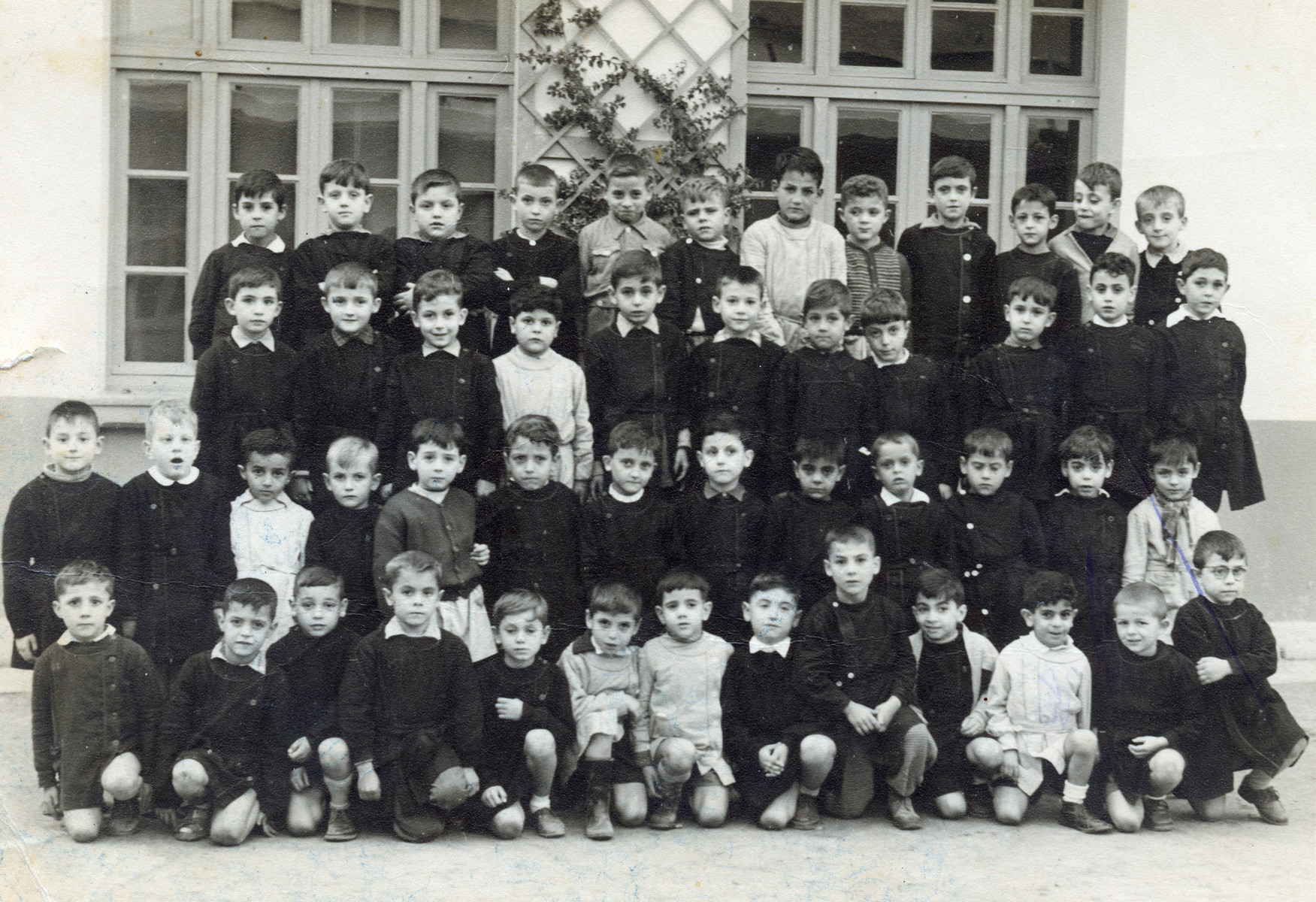 Ronnie Khayat 's first grade class in Tunis prior to his family's immigration to Israel.  Ronnie is in the first row, third boy from right. He is wearing a white shirt.