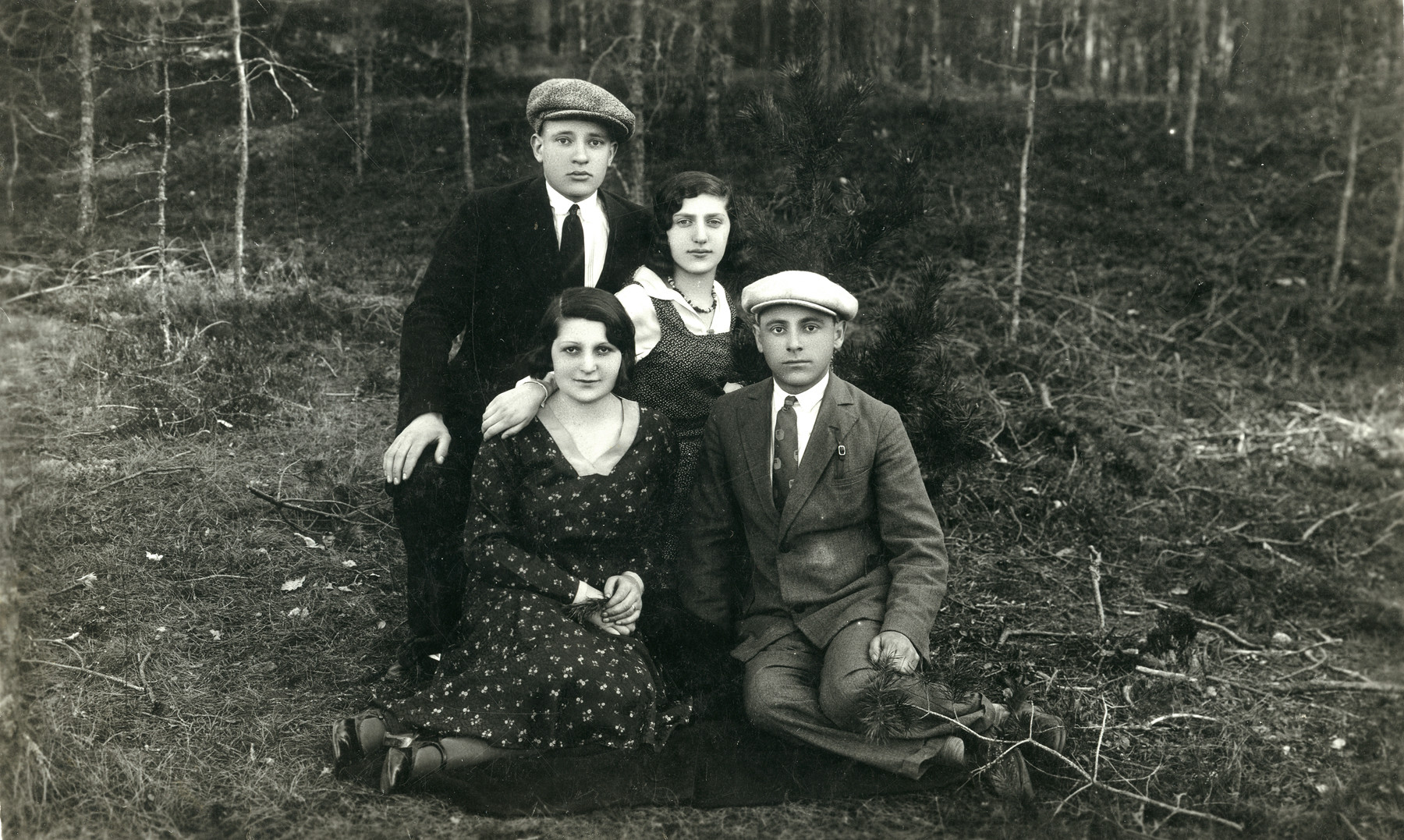 Two young couples poses outside in Vievis, Lithuania.   Rachel and Wolf Godrov are kneeling in the back row.