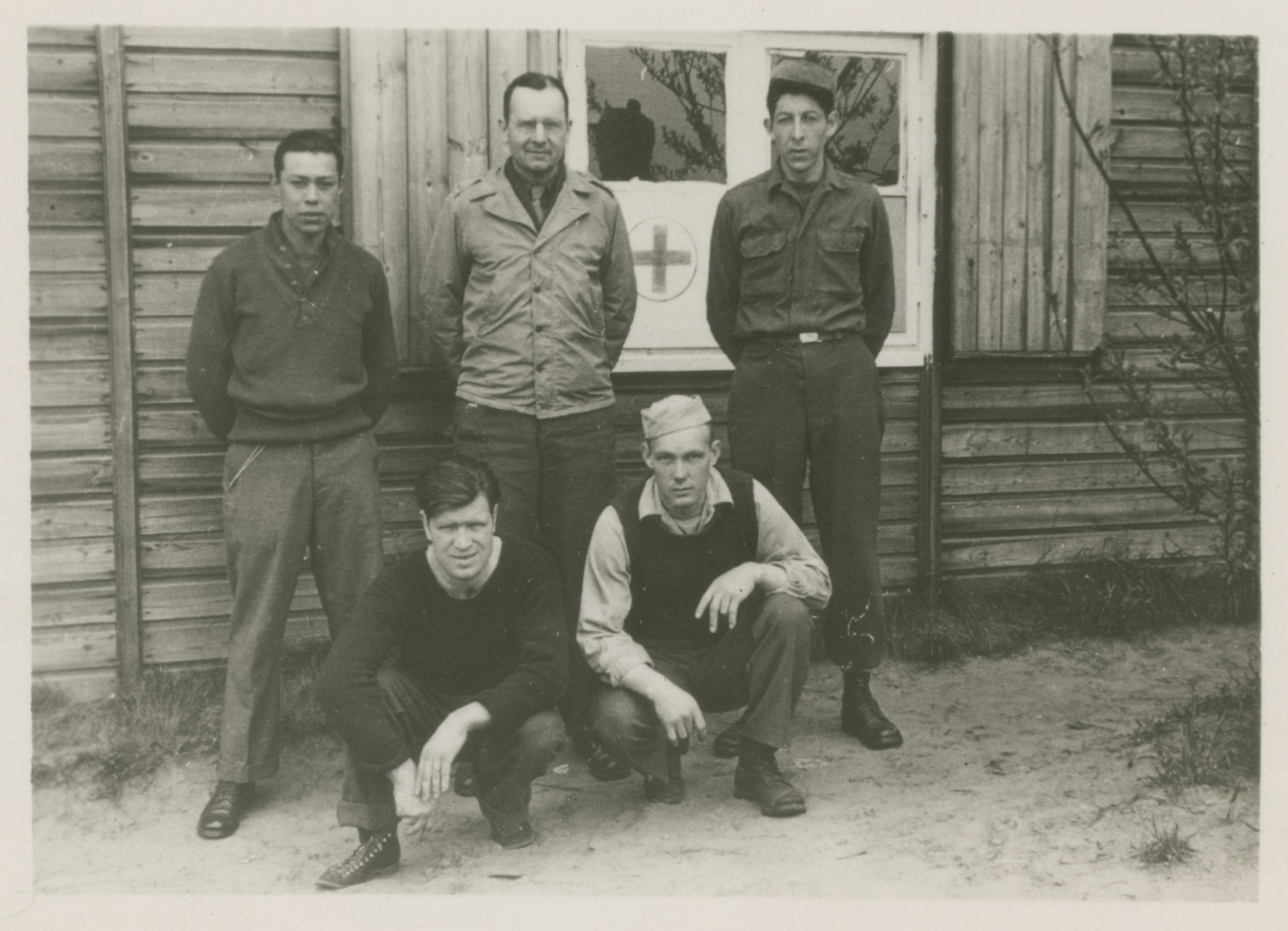 POWs pose outside a Red Cross building in Stalag Luft 1.