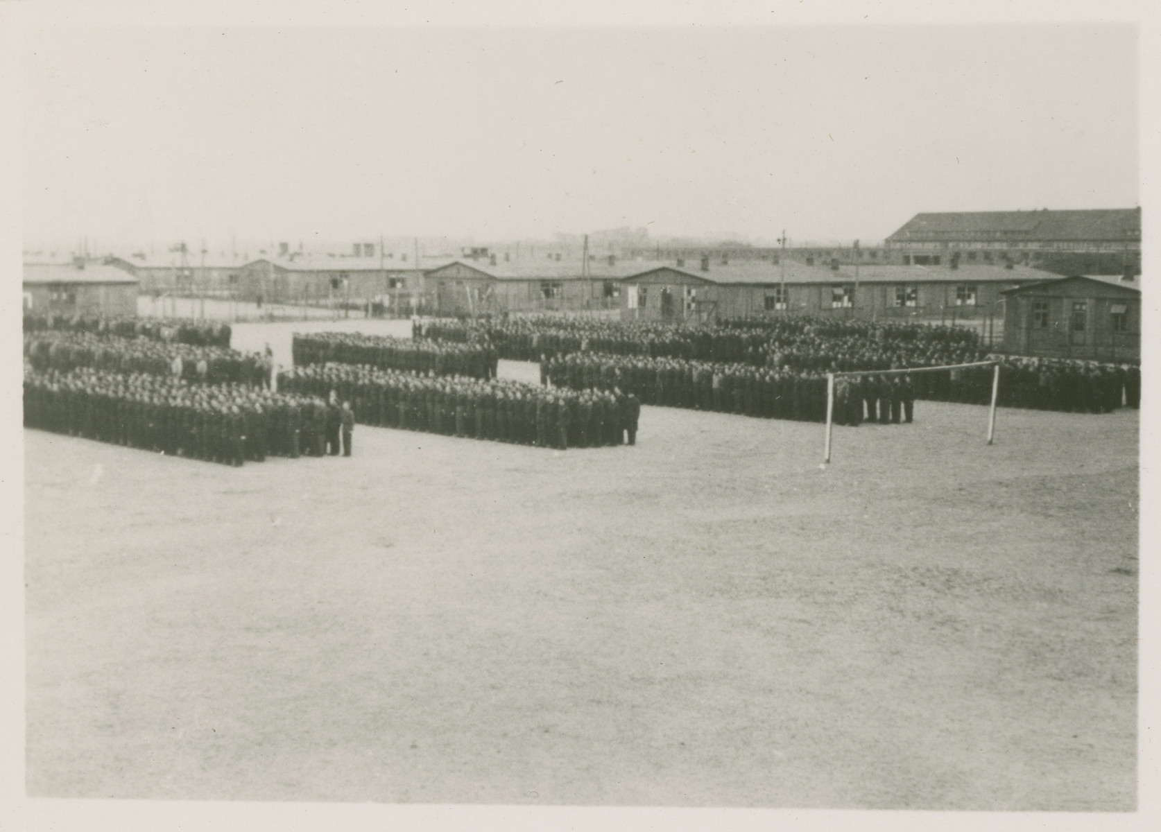 Prisoners line up in formation outside in Stalag Luft 1.