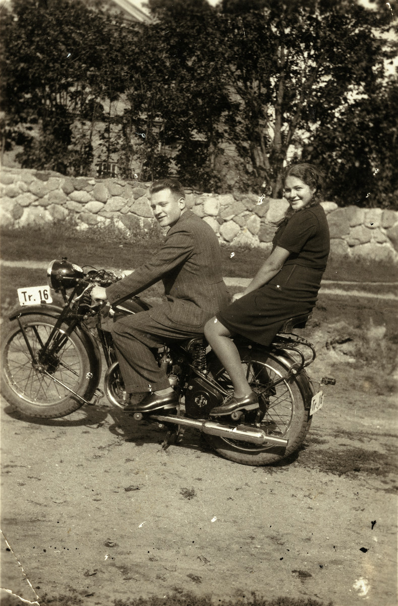 Wolf Godrov and his younger sister Sarah Rivka ride on a motorcycle.   Sarah Rivka perished.