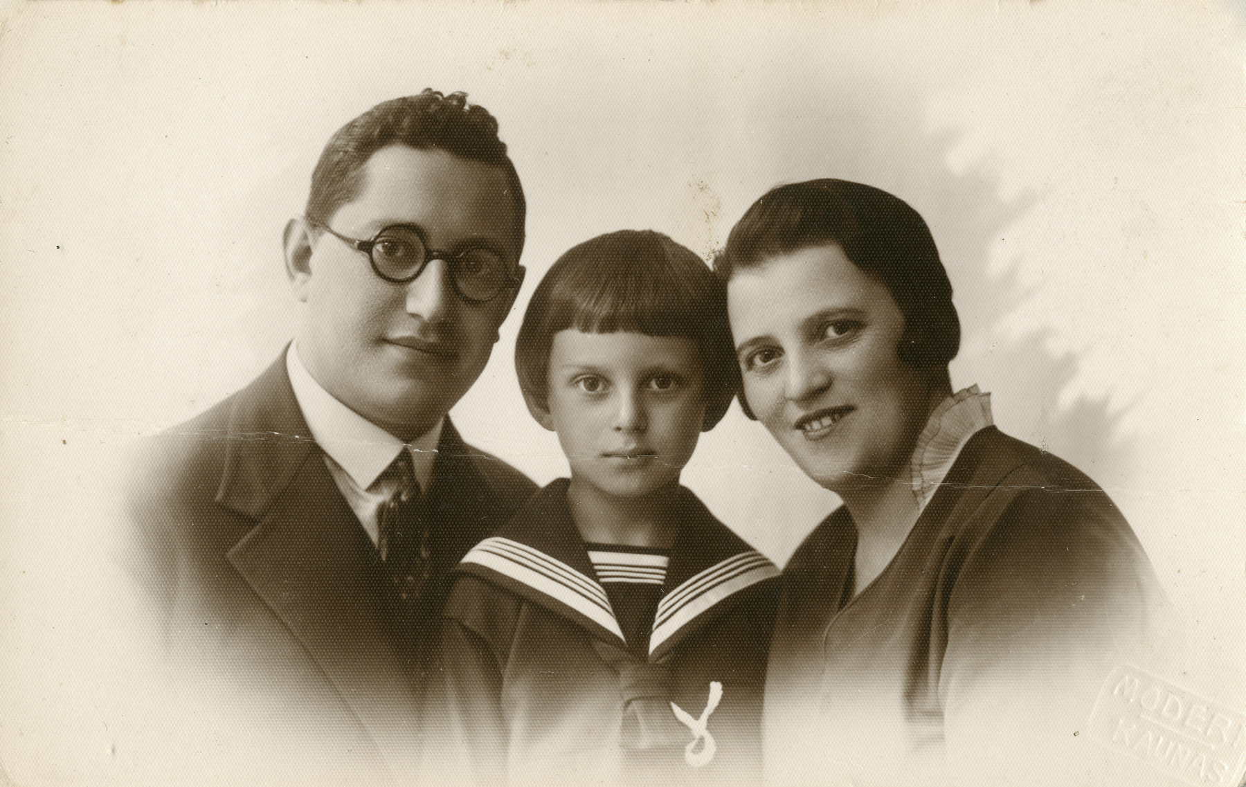 Studio portrait of Moshe Godroff and his wife Masha Gilerovich with their son Yaakov.   The family perished.