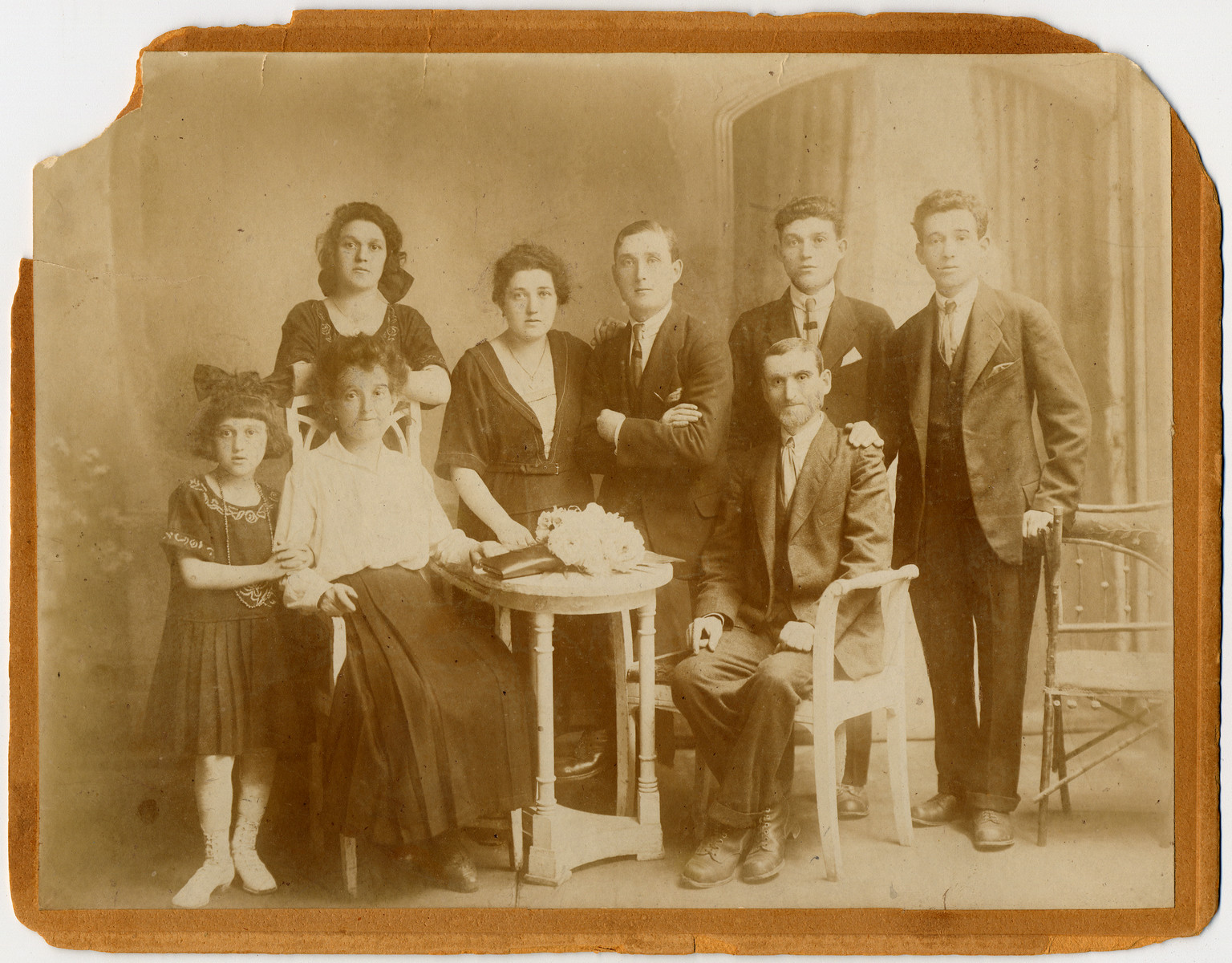 The Dauerman Family poses for a group photograph.  Seated are Rachel and Hirsch Dauerman. Israel Dauerman is on far right with his brother Aaron in the middle. Israel is the only known survivor in this picture. Aaron's son, Mark, immigrated in the United States in 1953.