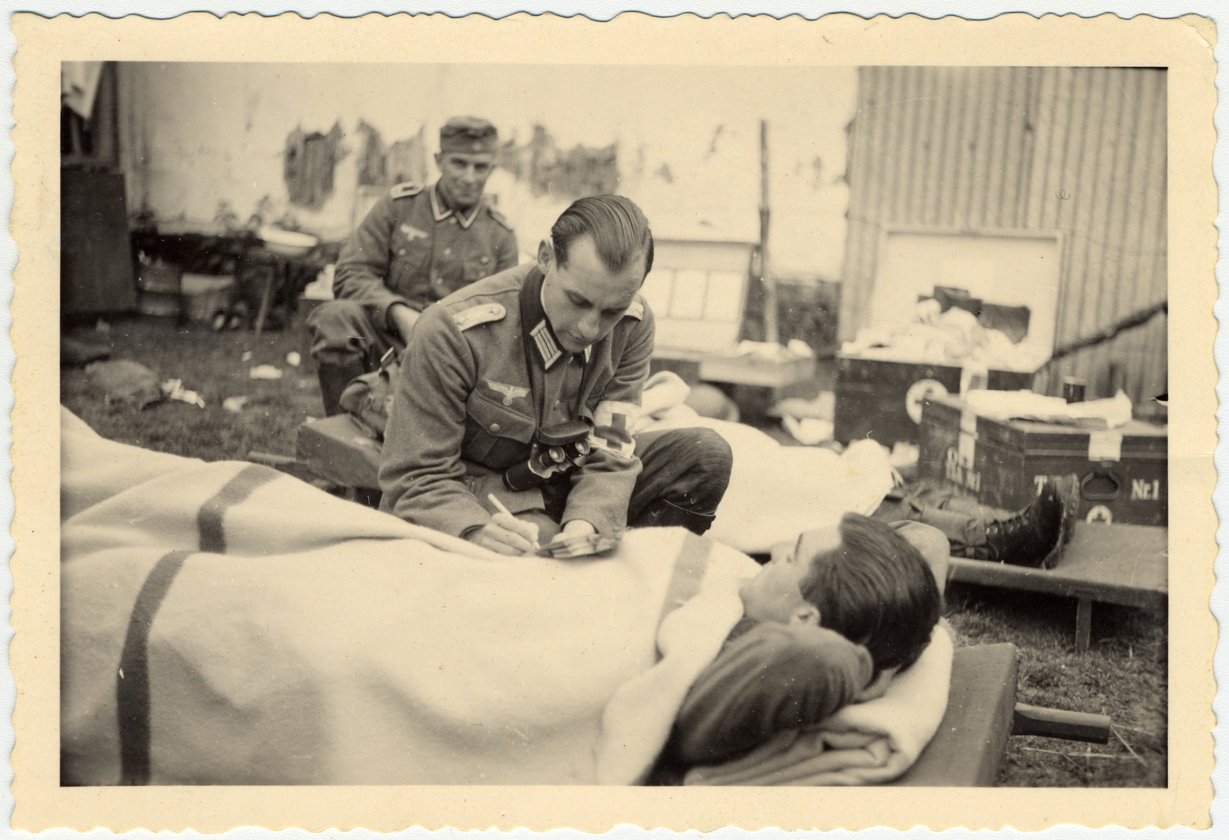 German army physician Bernhard Kullak peforms a medical examination in either a field hospital or training facility.