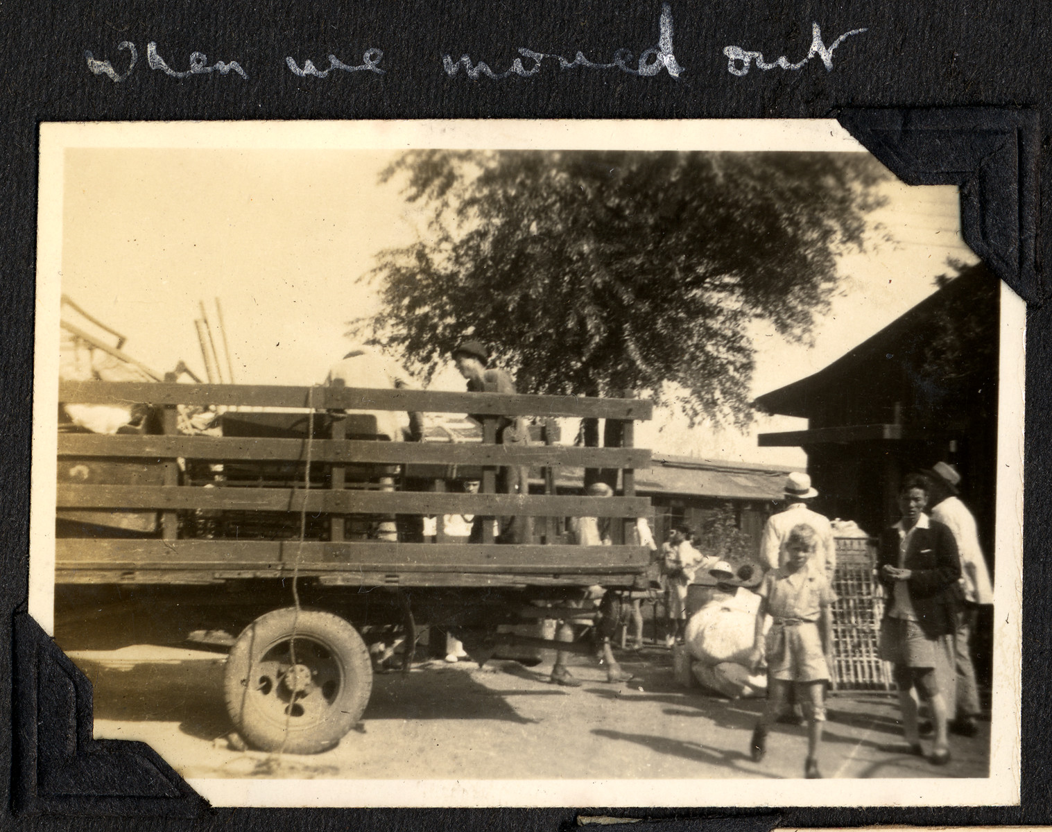 "Belongings are loaded onto a truck outside the Ash Colony in Shanghai.  The original caption reads: ""When we moved out."""