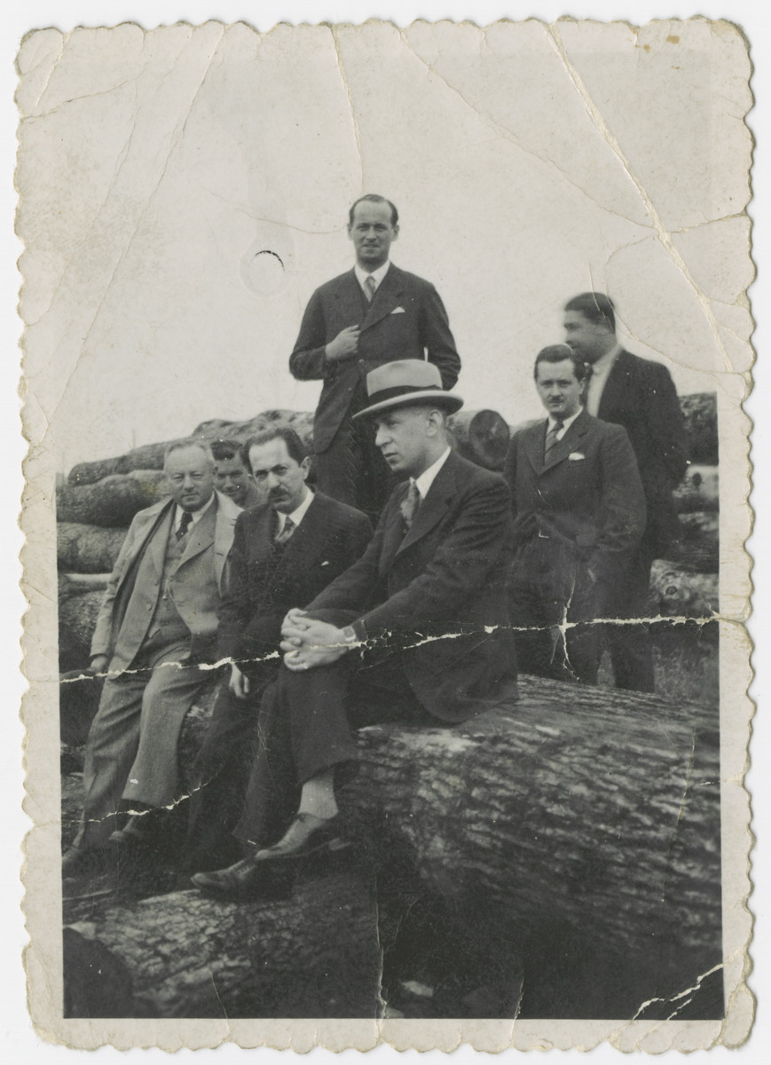 Hungarian Jewish businessmen inspect an oak forest that they have purchased for their lumber company.  Among those pictured are Lewis Friedlich and Ferenc Lorant (adoptive grandfather of the donor).