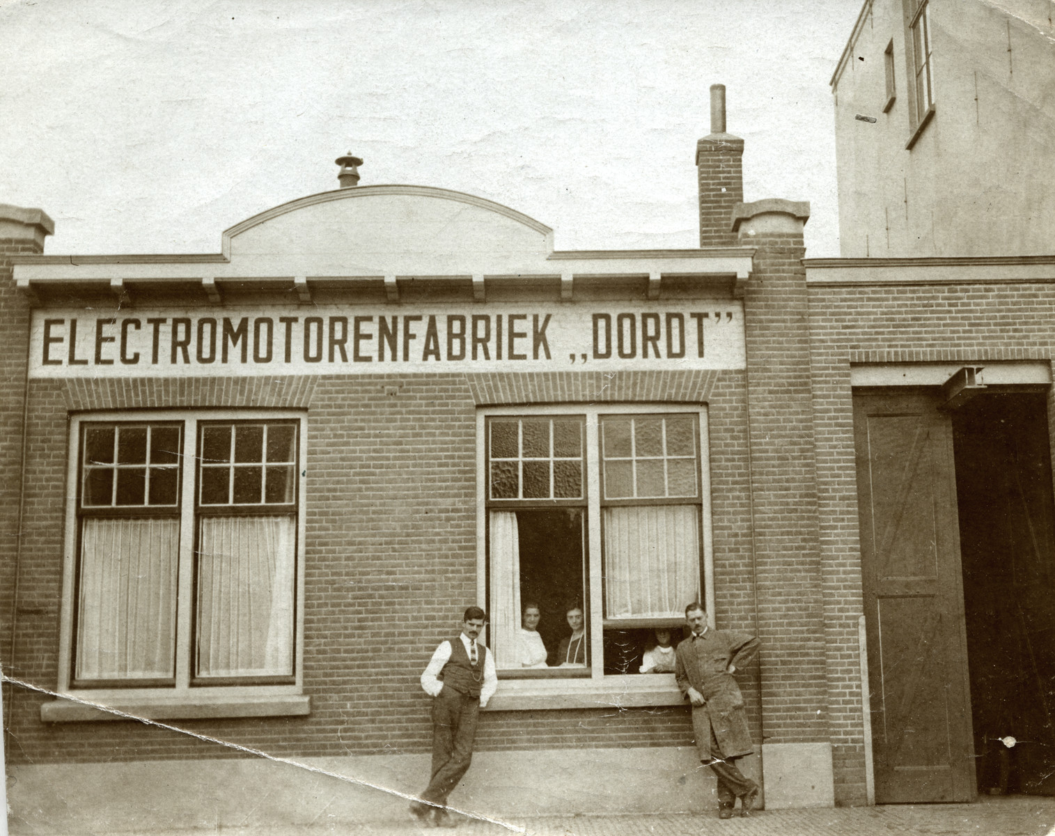 Adrian Lujten (right) and and his brother-in-law Roel Rosendaal (left) stand in front of their factory, the Electromotorenfabriek.